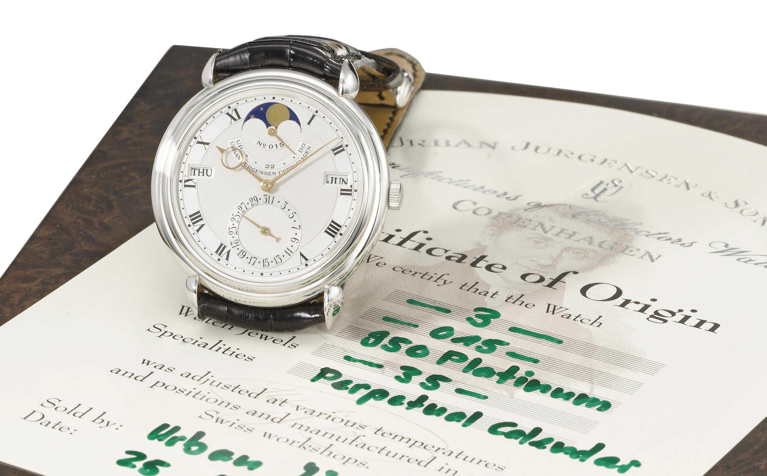 Urban Jürgensen. A fine platinum automatic perpetual calendar wristwatch with moon phases, power reserve, original certificate and box