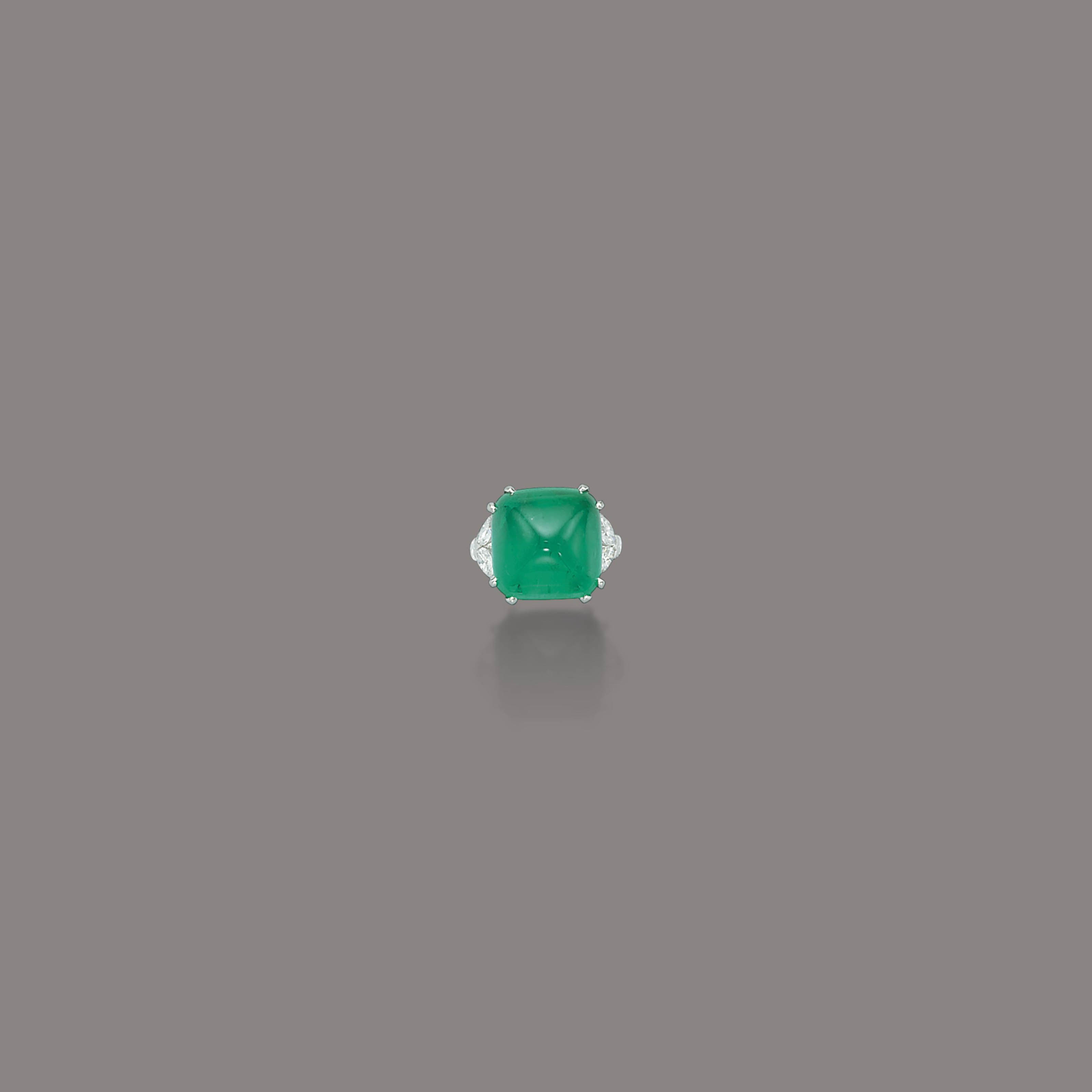 AN EMERALD AND DIAMOND RING, BY RUSER