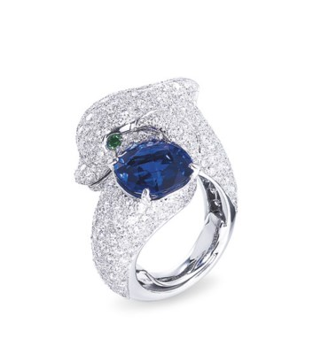 A SAPPHIRE DIAMOND AND EMERALD DOLPHIN RING BY CARTIER