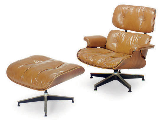 A ROSEWOOD AND TAN LEATHER-COVERED '670' LOUNGE CHAIR AND '671' OTTOMAN,