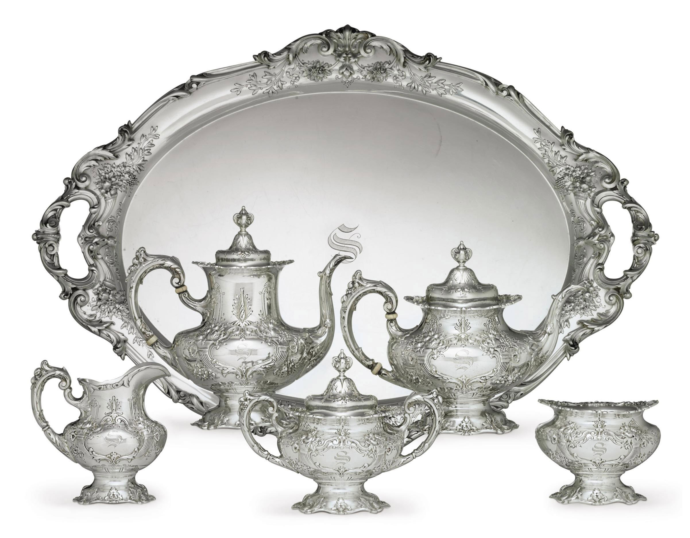 A FIVE-PIECE SILVER TEA AND COFFEE SERVICE WITH TRAY**