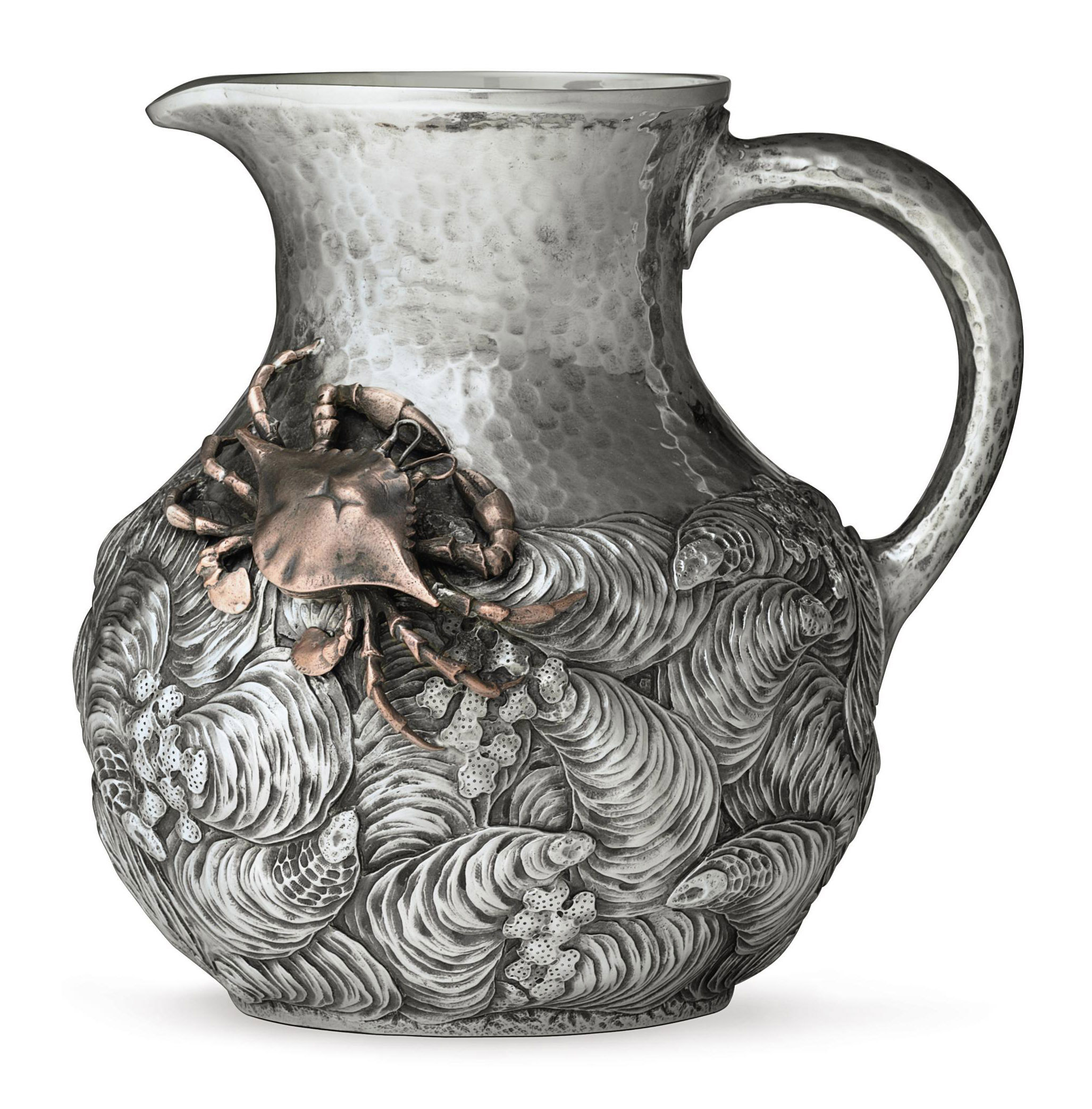 A SILVER AND MIXED-METAL WATER PITCHER