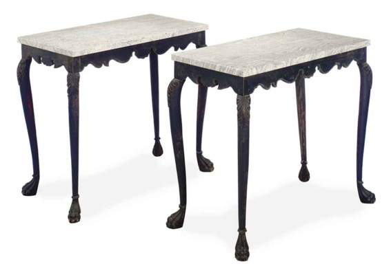 A PAIR OF EBONIZED MARBLE TOP