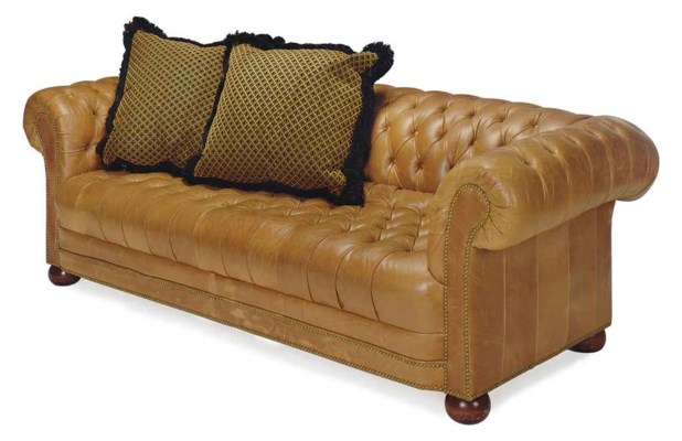 A BROWN LEATHER CLOSE NAILED U