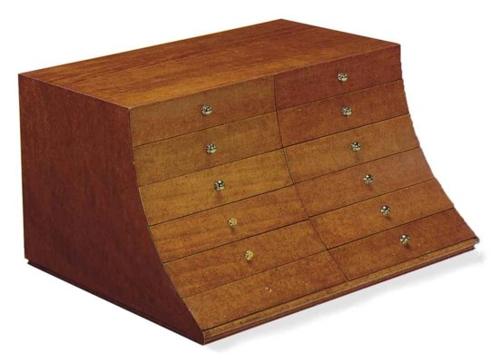 AN ELM LOW CHEST OF DRAWERS,