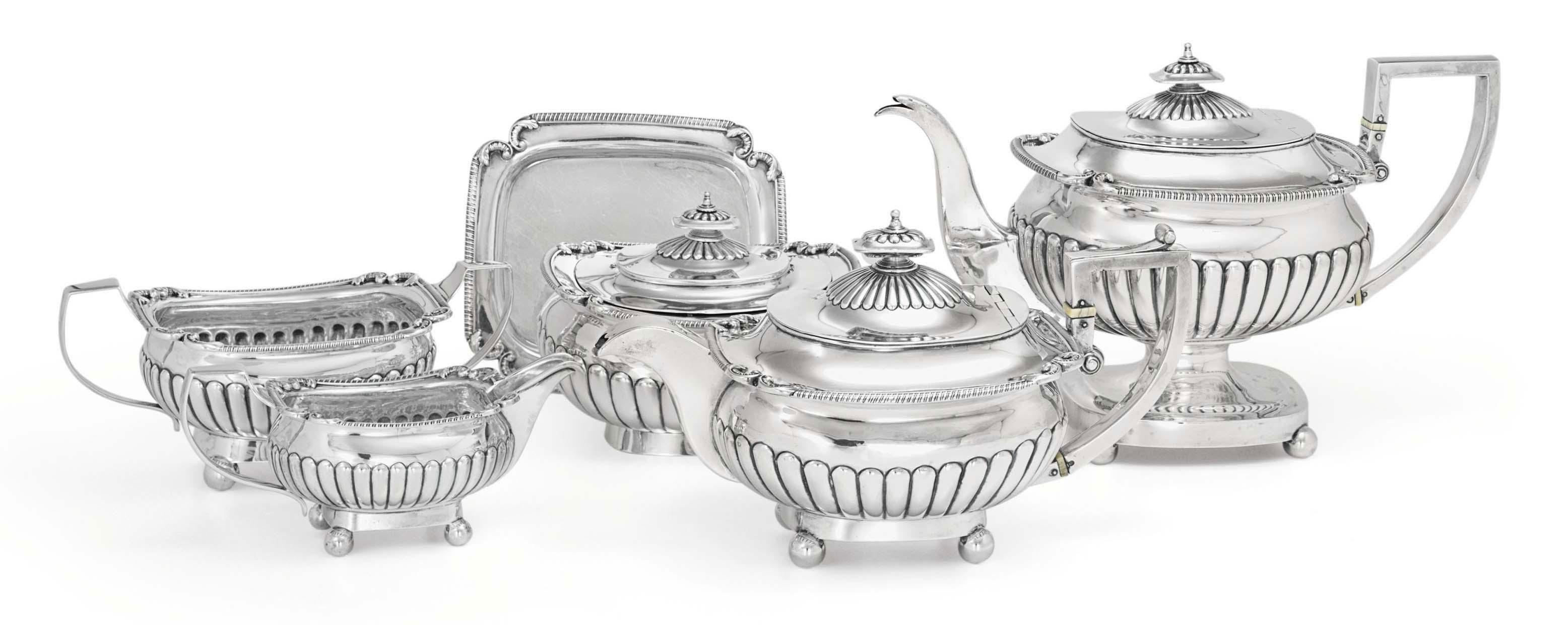 A GEORGE III SILVER FIVE-PIECE TEA AND COFFEE SERVICE**