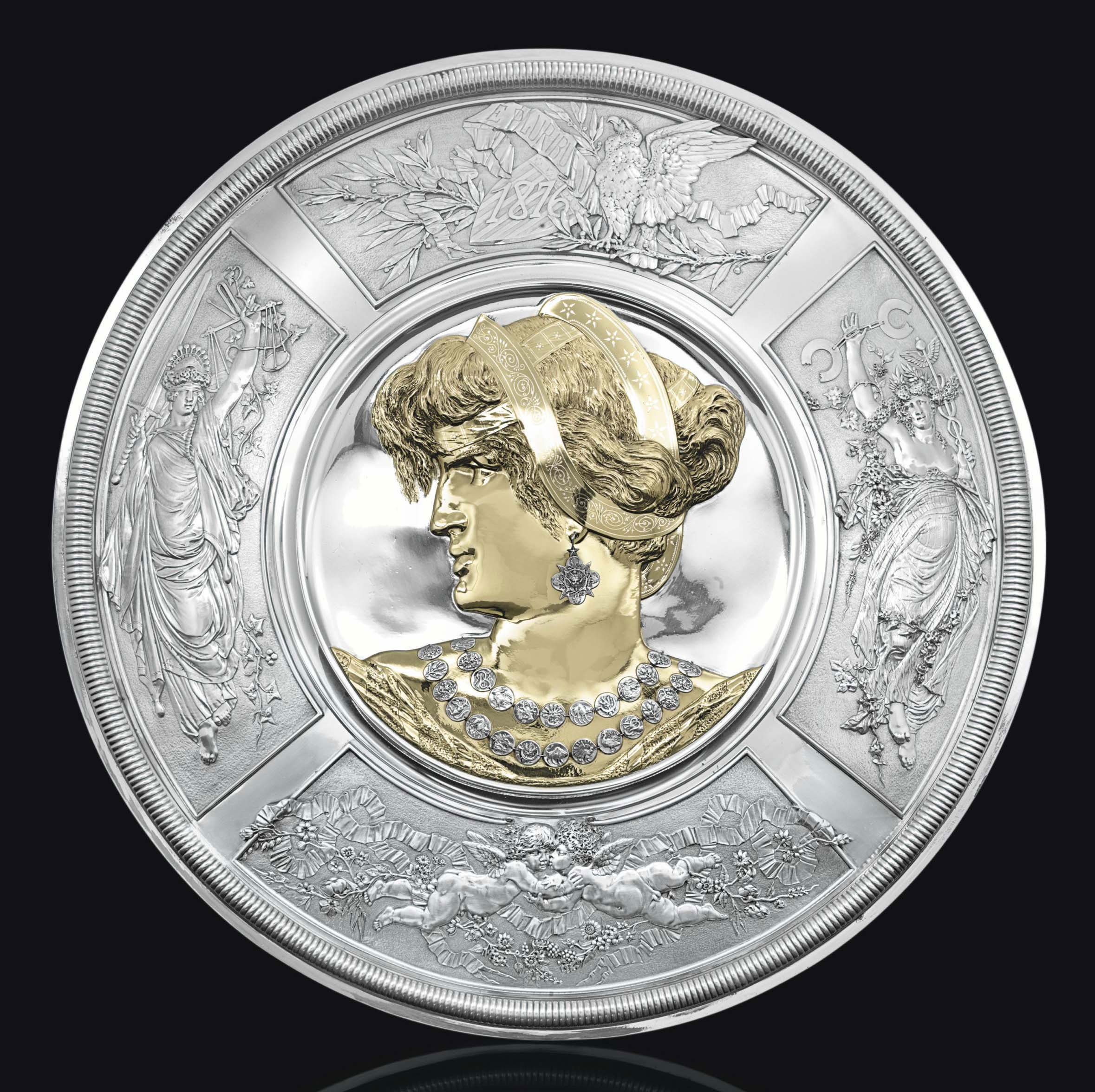 THE AMERICA SHIELD: A PARCEL-GILT SILVER PLAQUE FROM THE CENTENNIAL EXHIBITION OF 1876