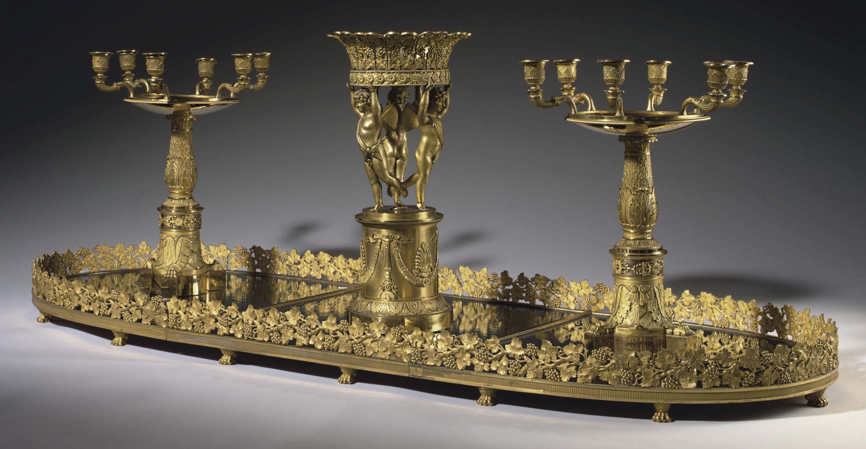 AN EMPIRE ORMOLU TABLE GARNITURE