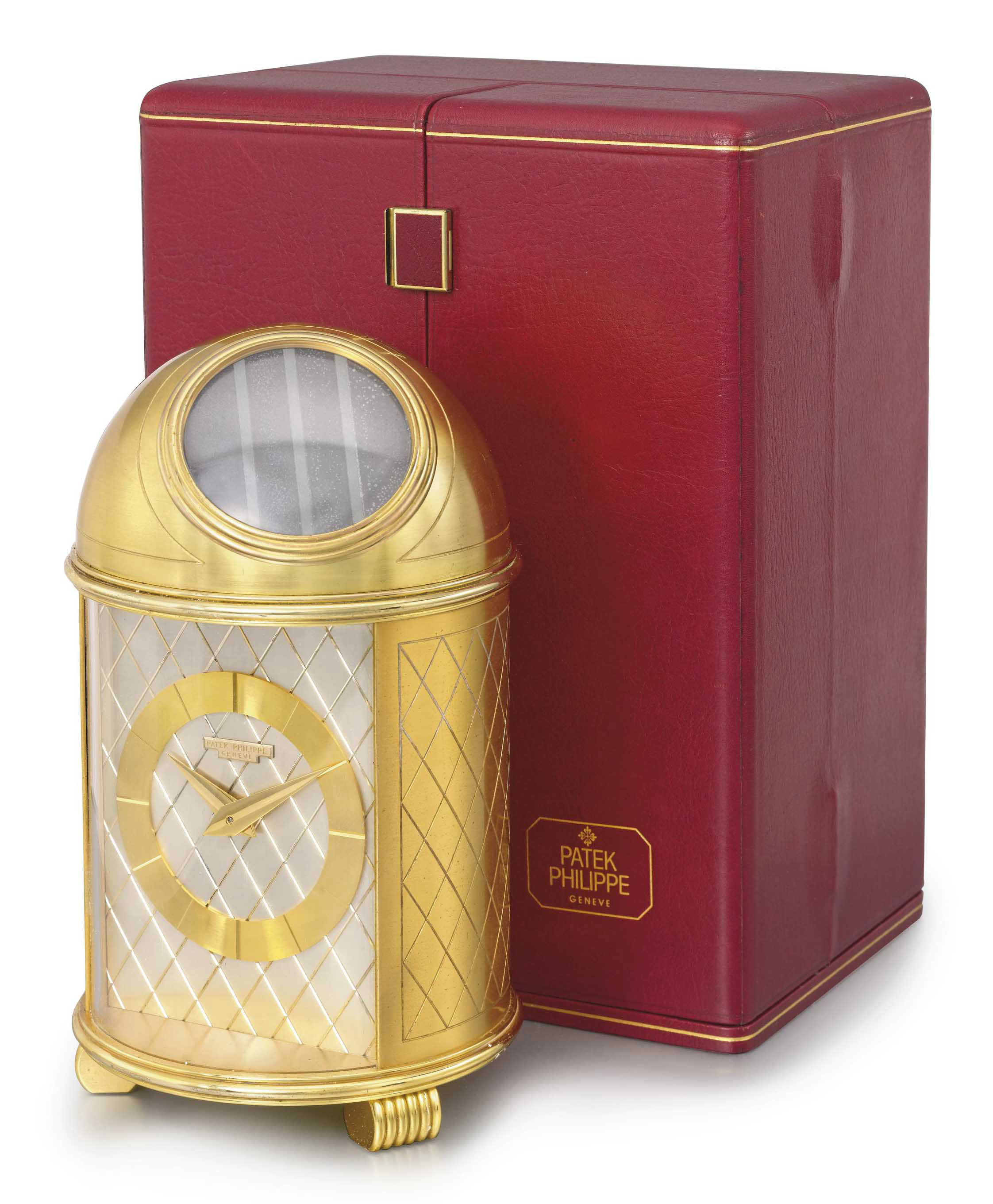 PATEK PHILIPPE. A FINE GILT BRASS SOLAR-POWERED DOMED TABLE CLOCK WITH ORIGINAL FITTED PRESENTATION BOX