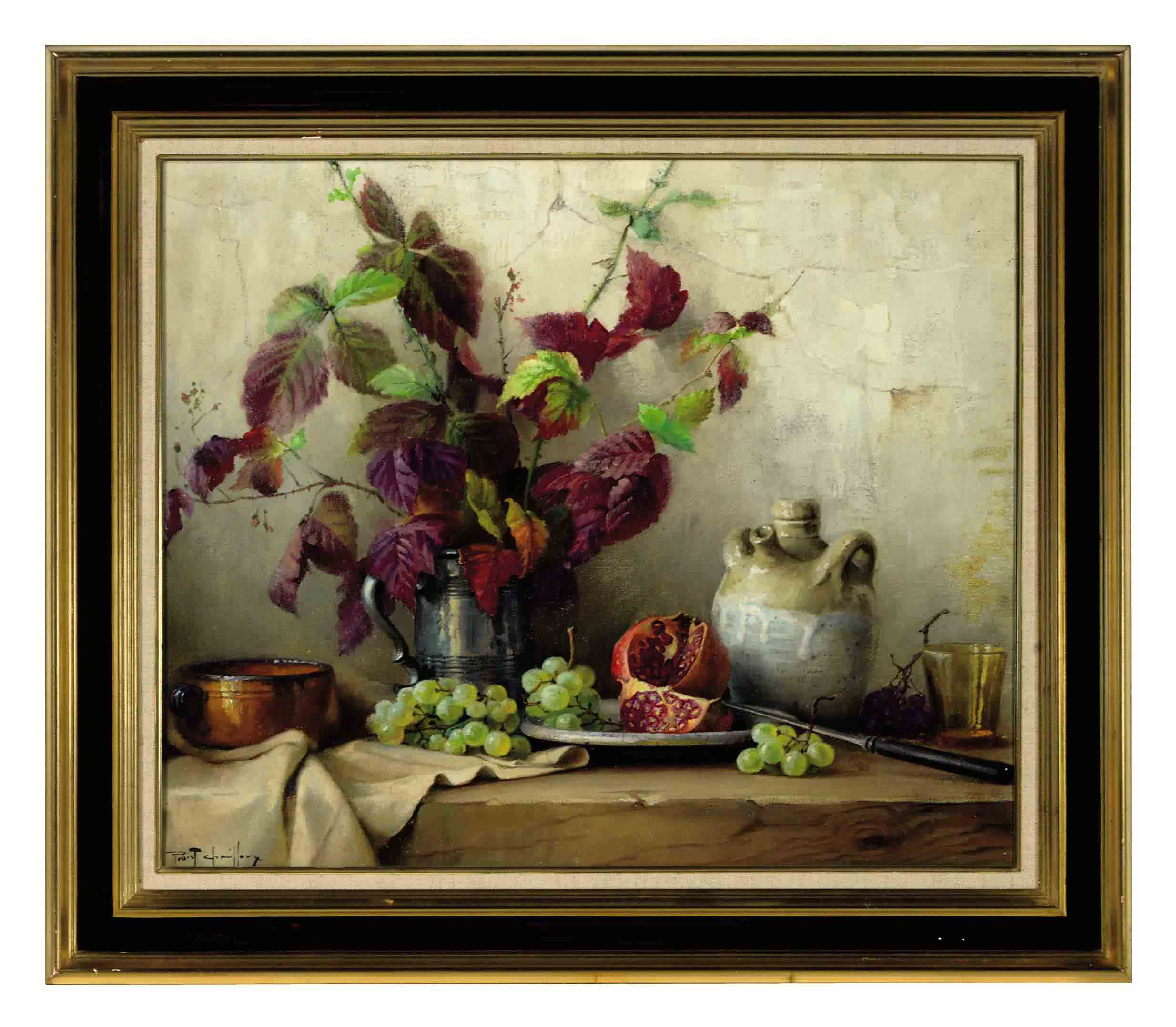 Still life of a pitcher holding autumn leaves and a pomegranate and grapes on a ledge