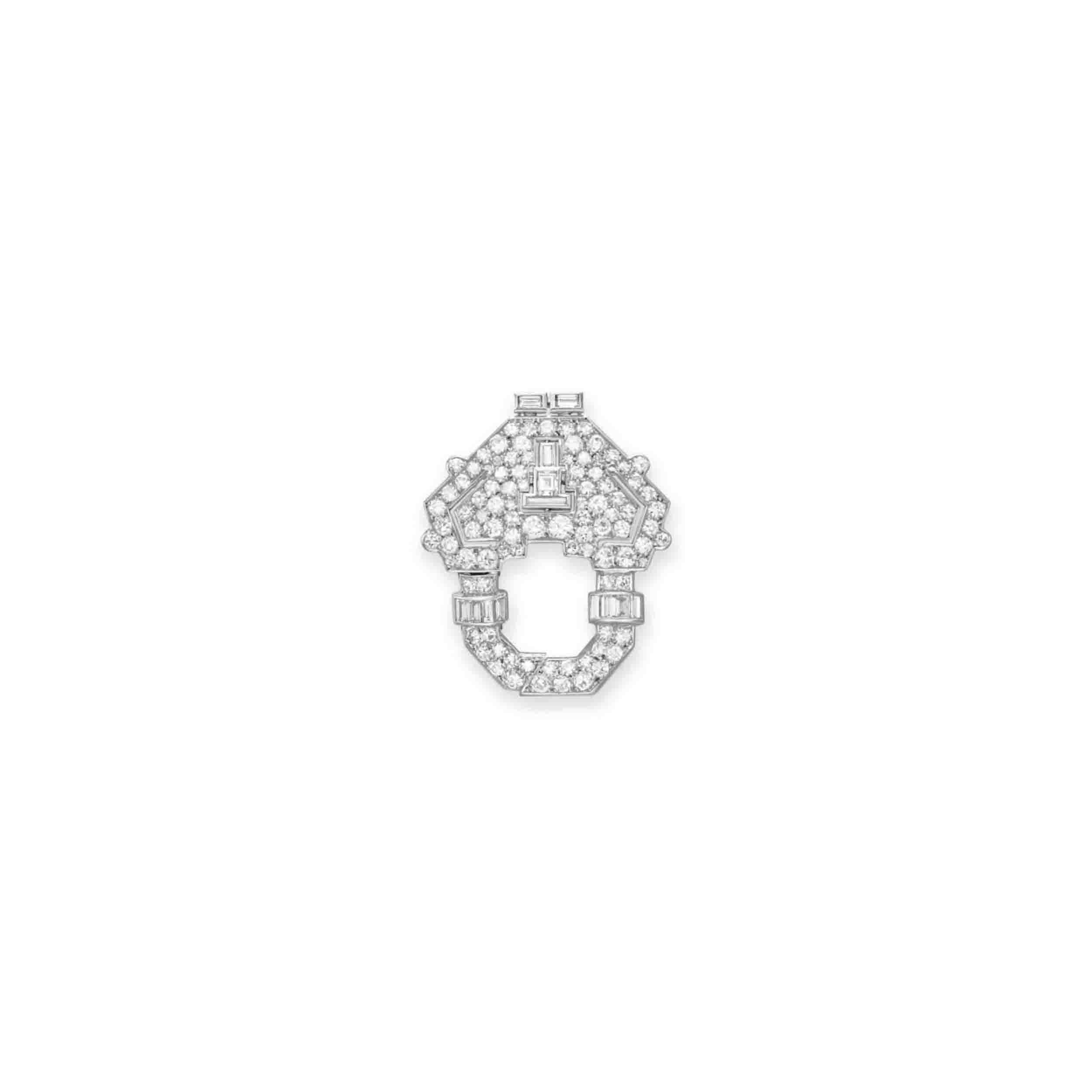 AN ART DECO DIAMOND BROOCH, BY GHISO
