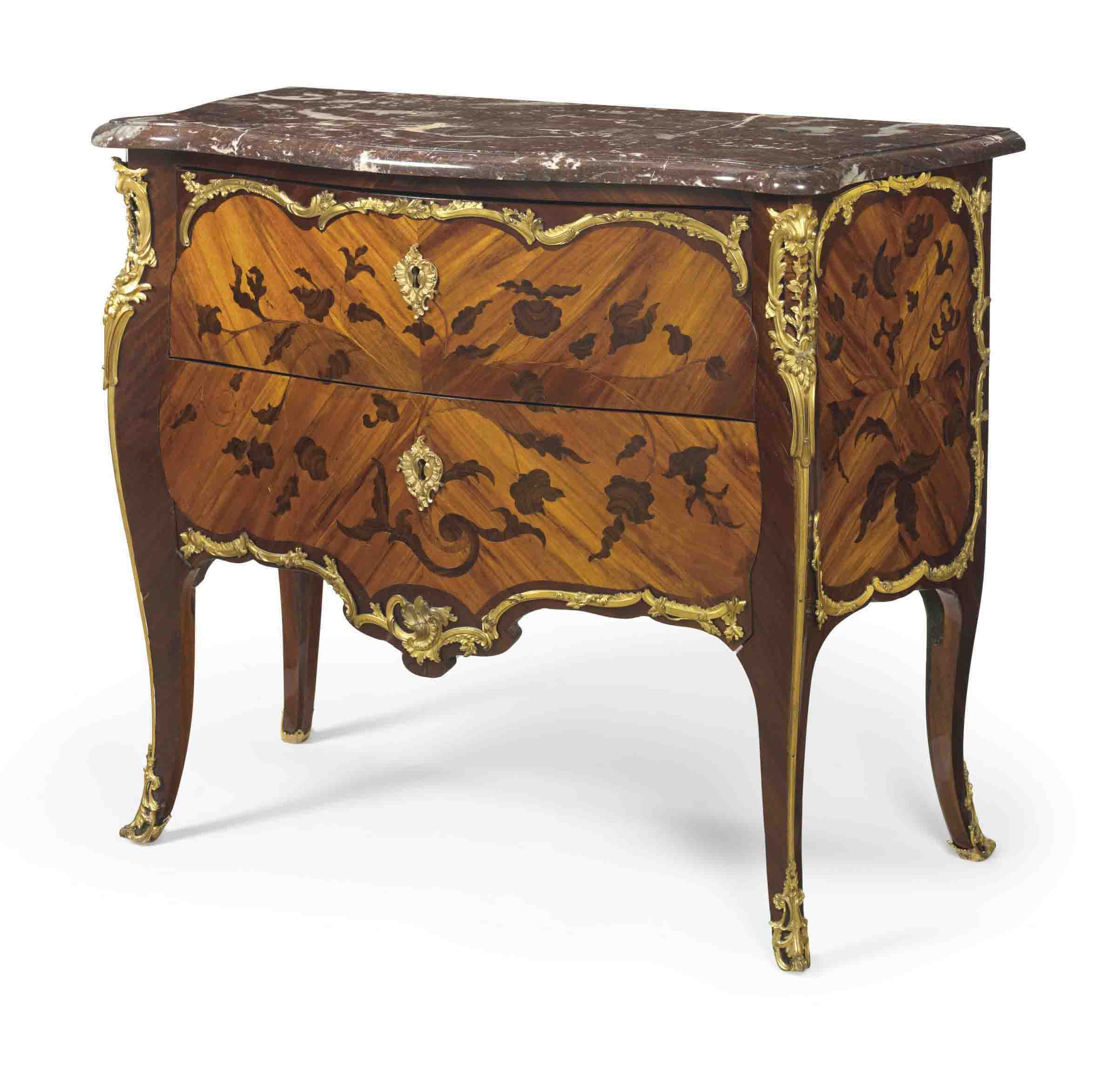 A LOUIS XV ORMOLU-MOUNTED TULIPWOOD AND BOIS DE BOUT MARQUETRY COMMODE