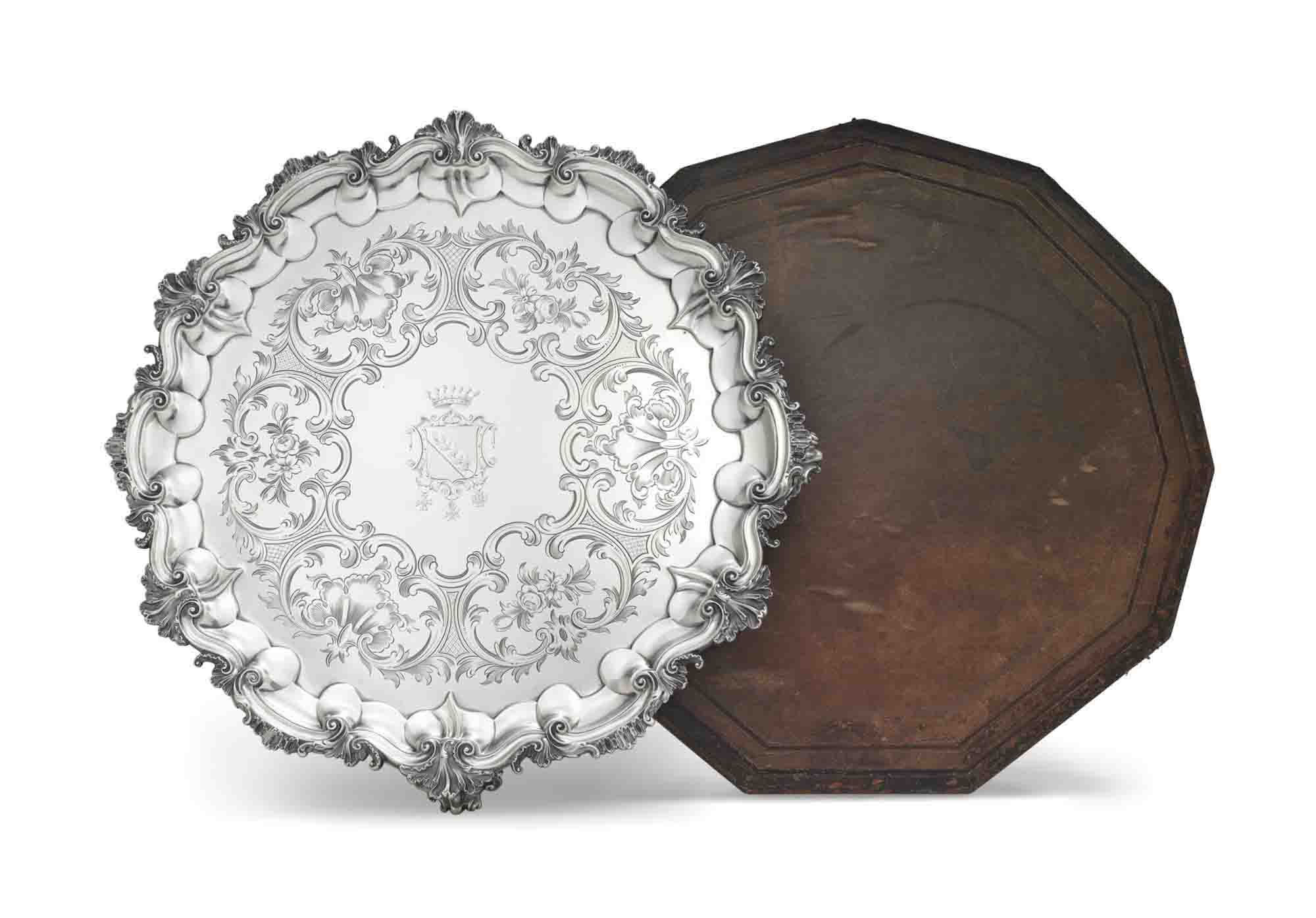 A LARGE VICTORIAN SILVER SALVER IN LEATHER CASE