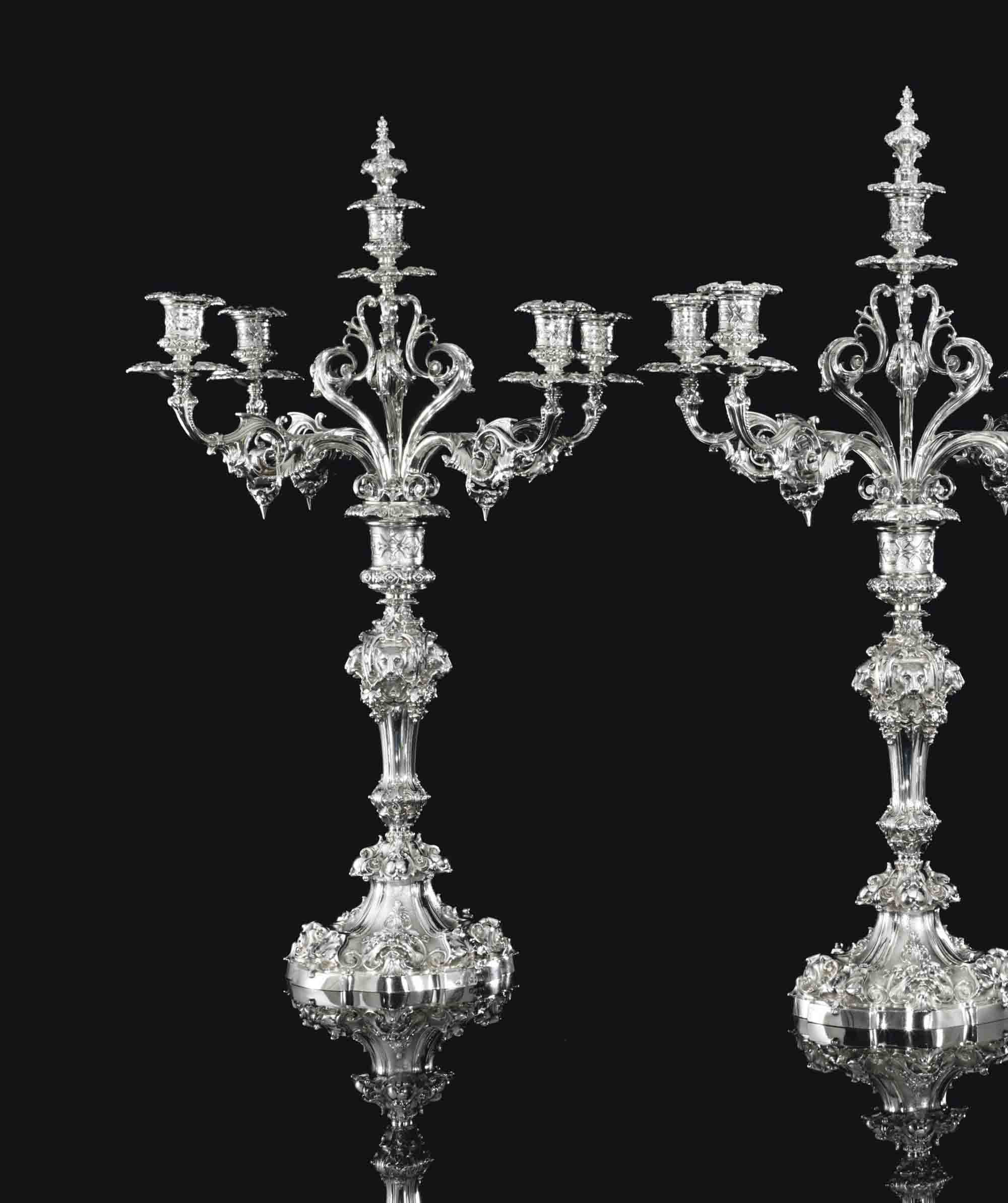 A PAIR OF VICTORIAN SILVER FIVE-LIGHT CANDELABRA