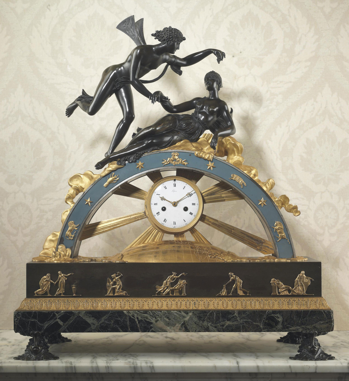 AN EMPIRE ORMOLU, PATINATED BRONZE AND VER DE MER MARBLE MANTEL CLOCK