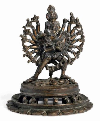 A bronze figure of Hevajra and