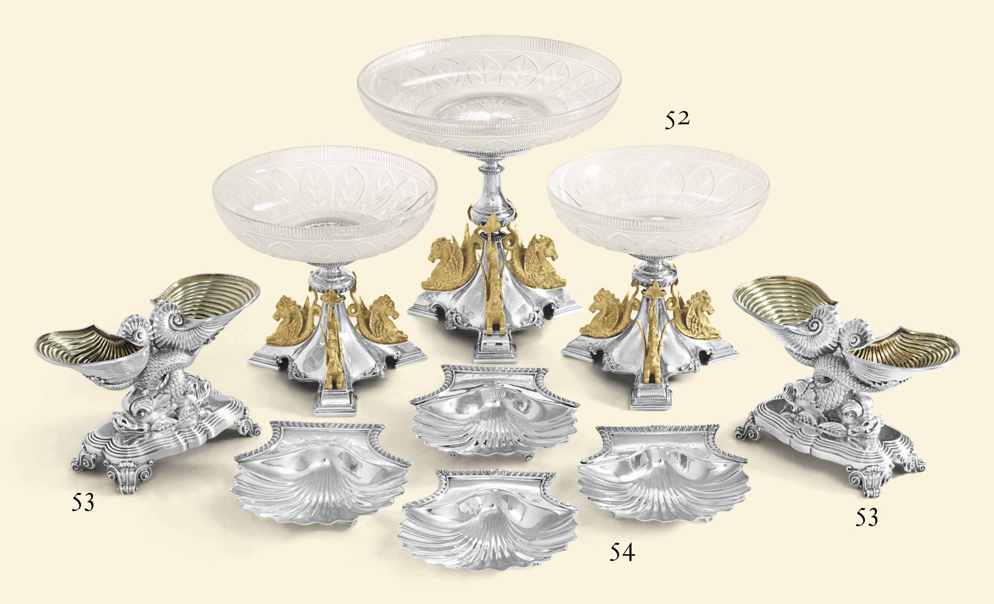 A VICTORIAN PARCEL-GILT SILVER THREE-PIECE TABLE GARNITURE
