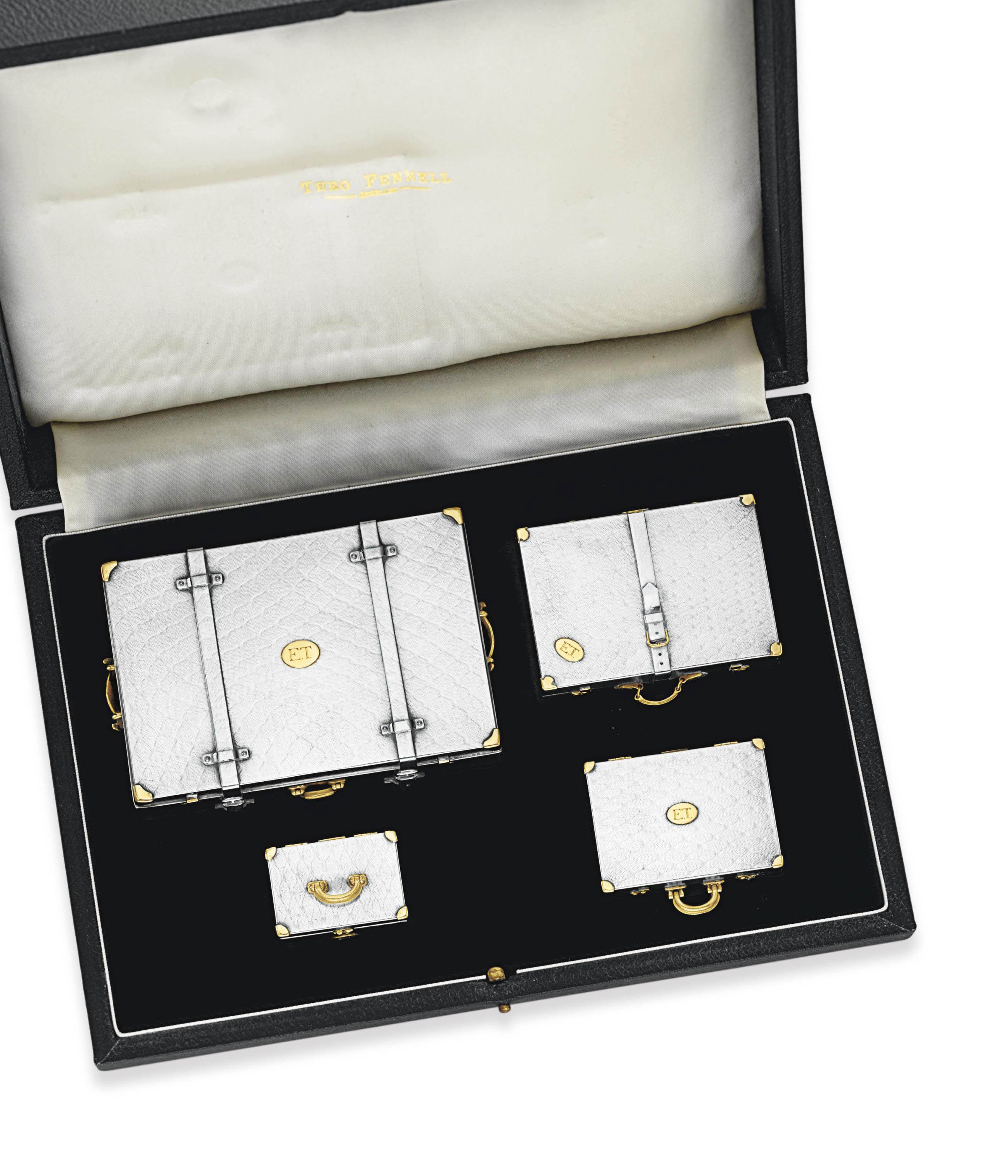 A SET OF SILVER AND GOLD BOXES, BY THEO FENNELL