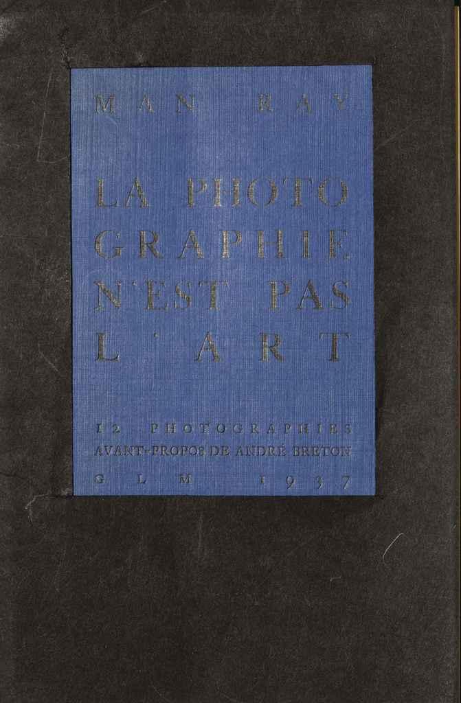 """MAN RAY. La Photographie n'est pas l'art. Avant-propos d'André Breton. Paris: G.L.M., 1937. In-4 (245 x 160 mm). 12 planches reproduisant des photographies de Man Ray, imprimées sur papier jaune. En feuilles, sous double couverture originale de l'éditeur: la première en carton bleu avec le titre imprimé (légèrement passée), la seconde en noir avec fenêtre laissant apparaître le titre (petites déchirures restaurées). Édition originale. """"La Photographie n'est pas l'art is one of the most enigmatic yet advanced of all his books. The images are set off against a typical nonsense 'text' by the founder of Surrealism André Breton"""" (Parr & Badger). Bon exemplaire de ce grand classique. Parr-Badger I, pp. 108-109."""