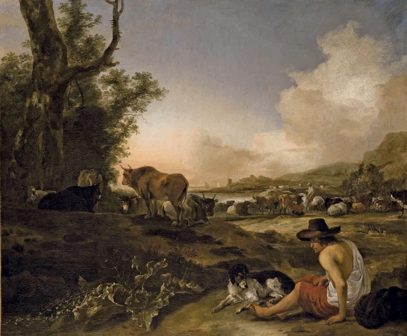 Berger assis dans un paysage avec son chien
