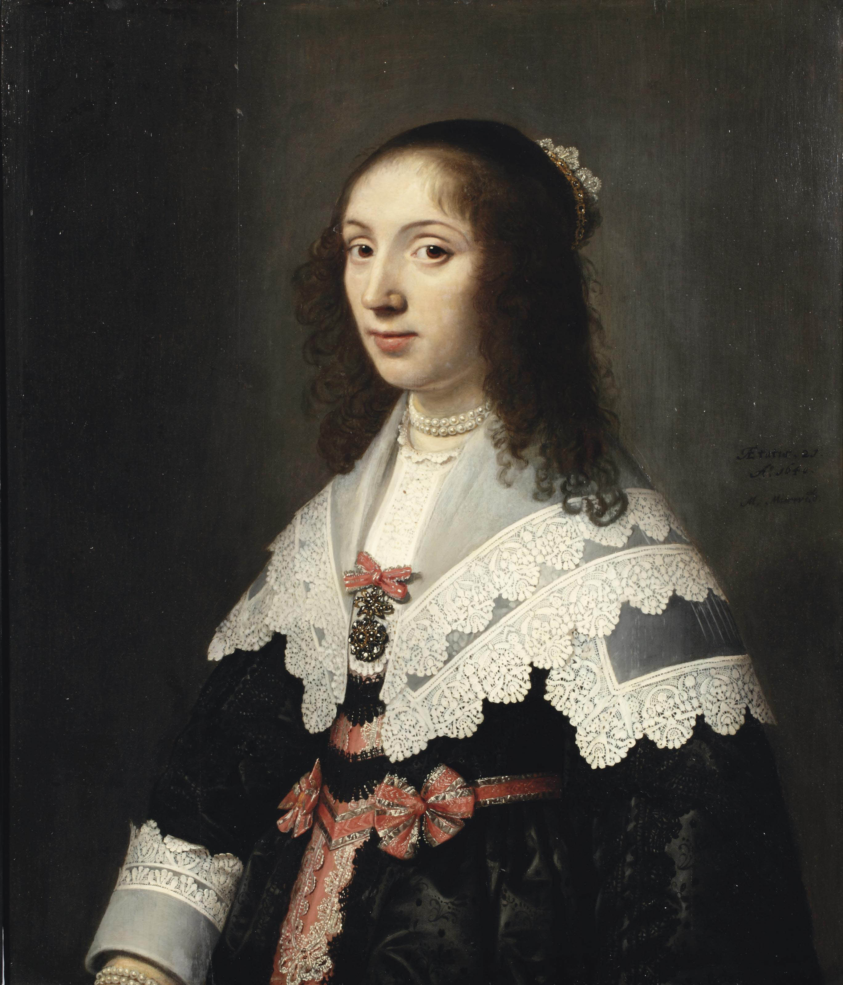 Portrait of Agatha de Vlaming van Oudtshoorn (1619-1675), half-length, in an embroidered black dress with red and silver silk decorations, with a white lace collar and cuffs, a pearl necklace and a jewelled tiara
