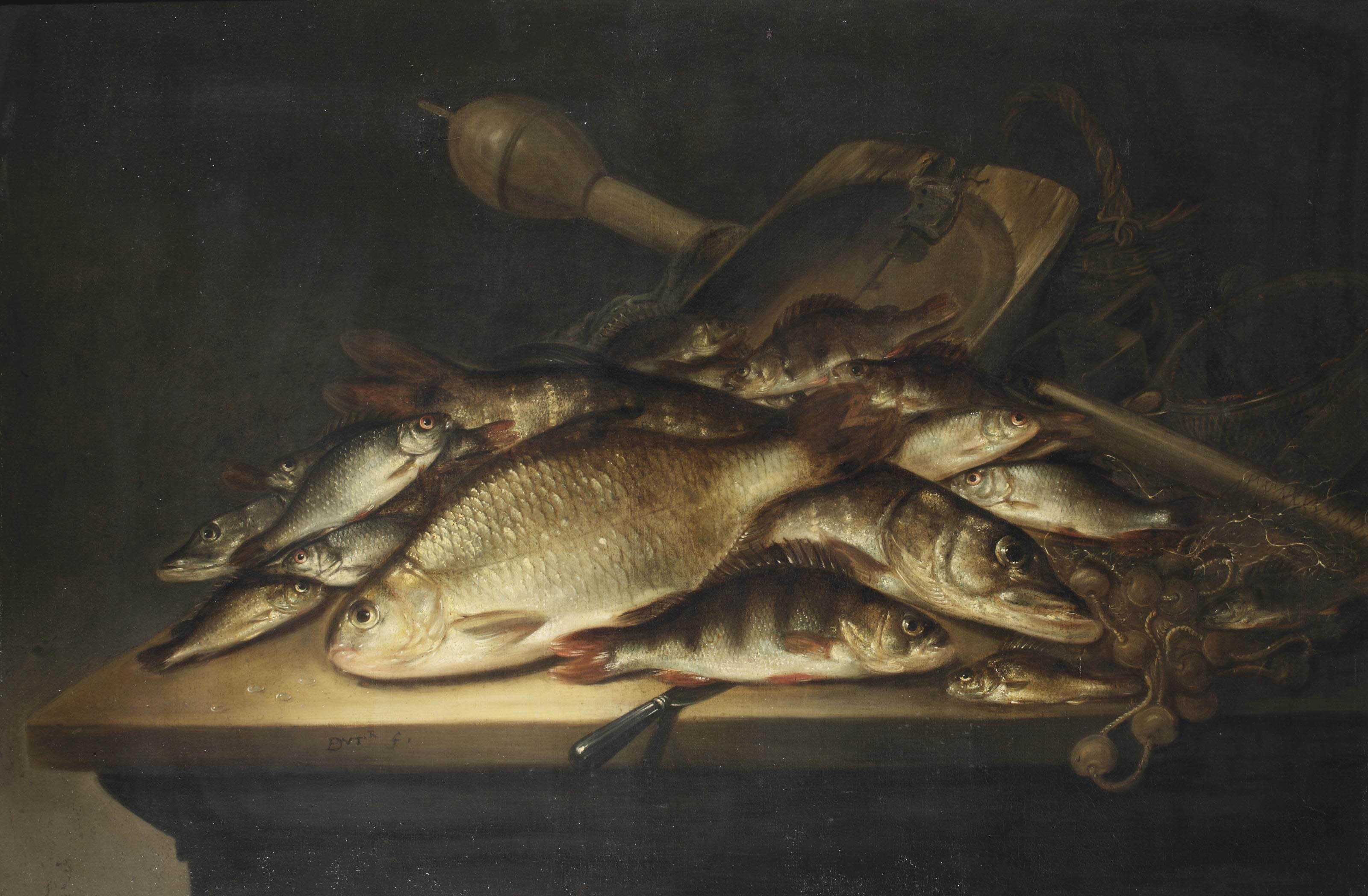 A pike, a carp, a perch, and various other fish, nets and other fishing equipment on a table