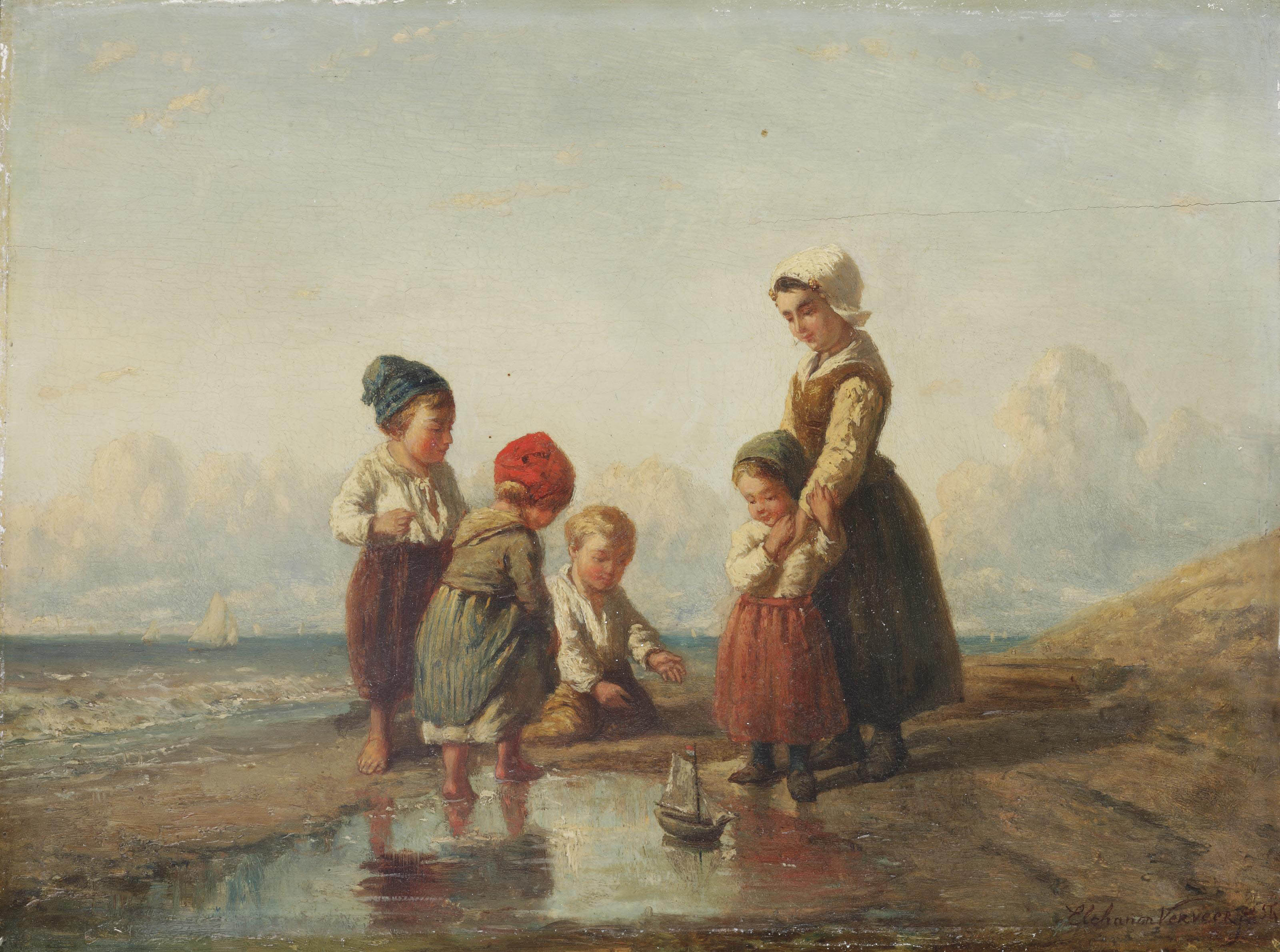 Children playing with a boat on the beach