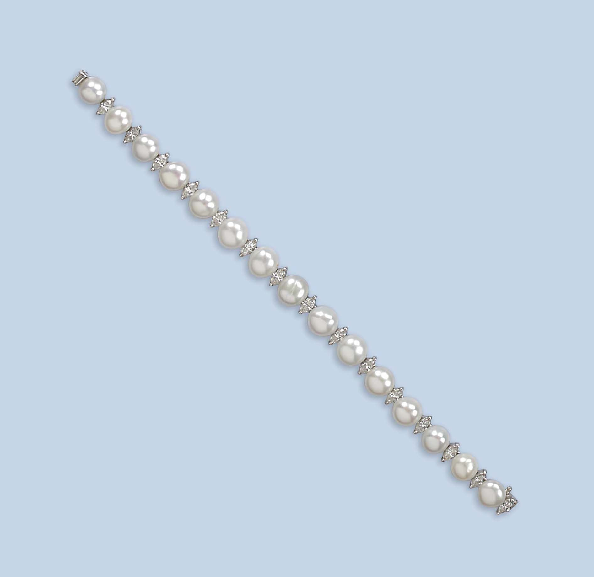 A CULTURED PEARL AND DIAMOND BRACELET, BY RENÉ KERN, AND A DIAMOND RING