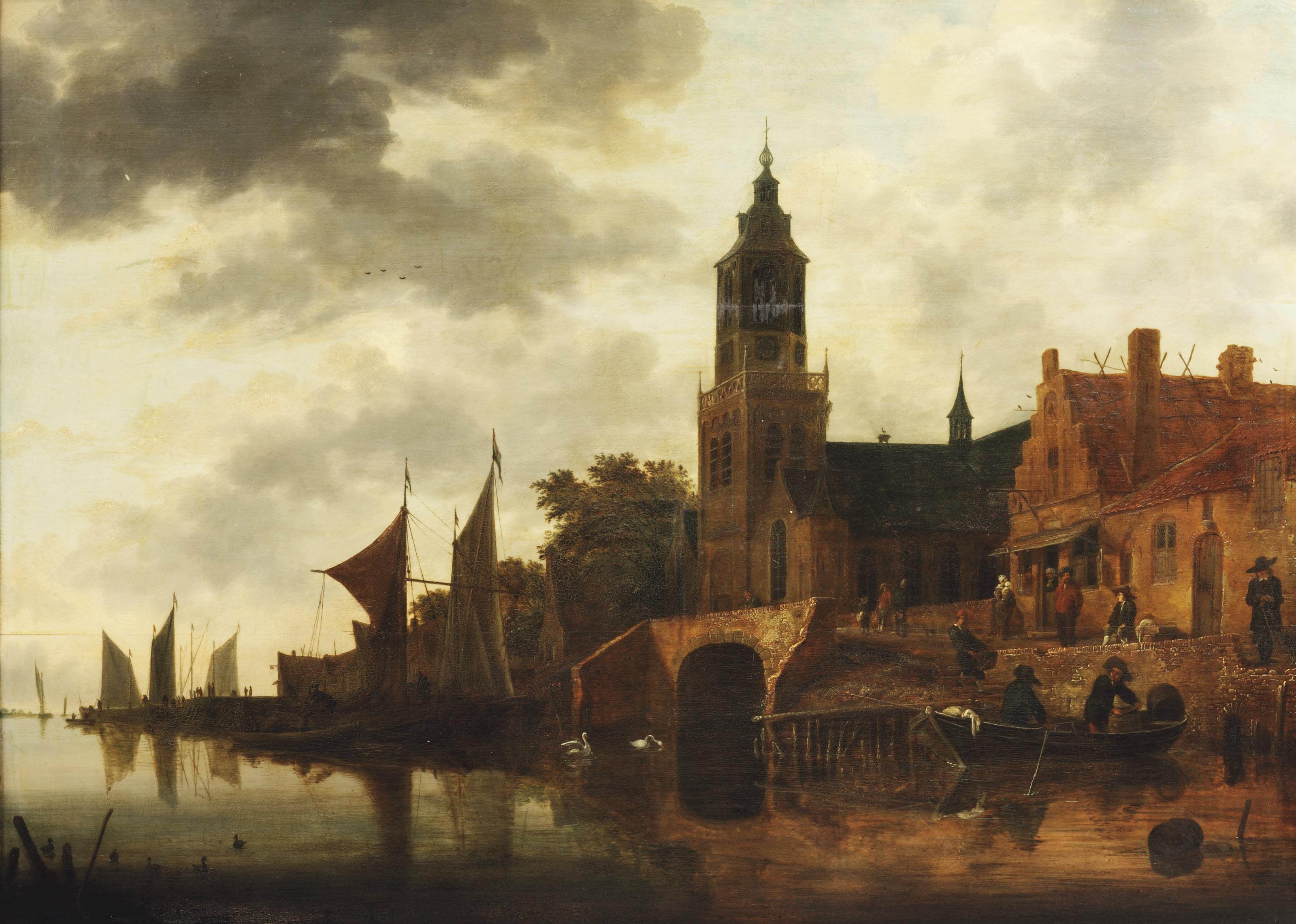 A river landscape with figures outside an inn on the river bank