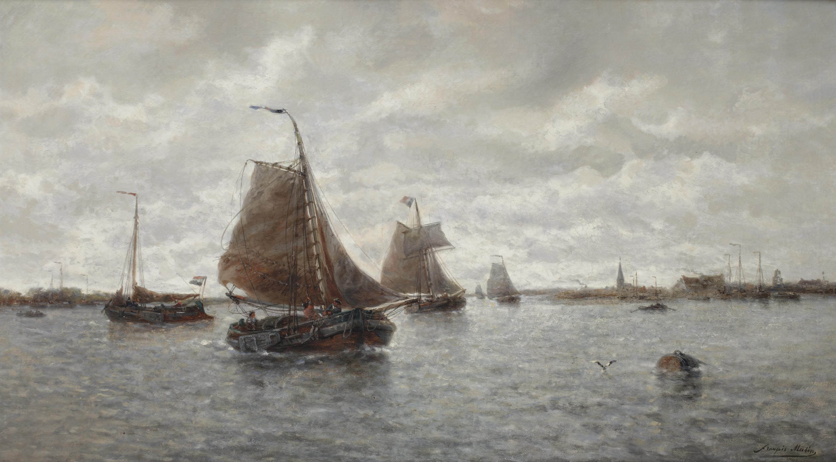 Sailing vessels on a busy river