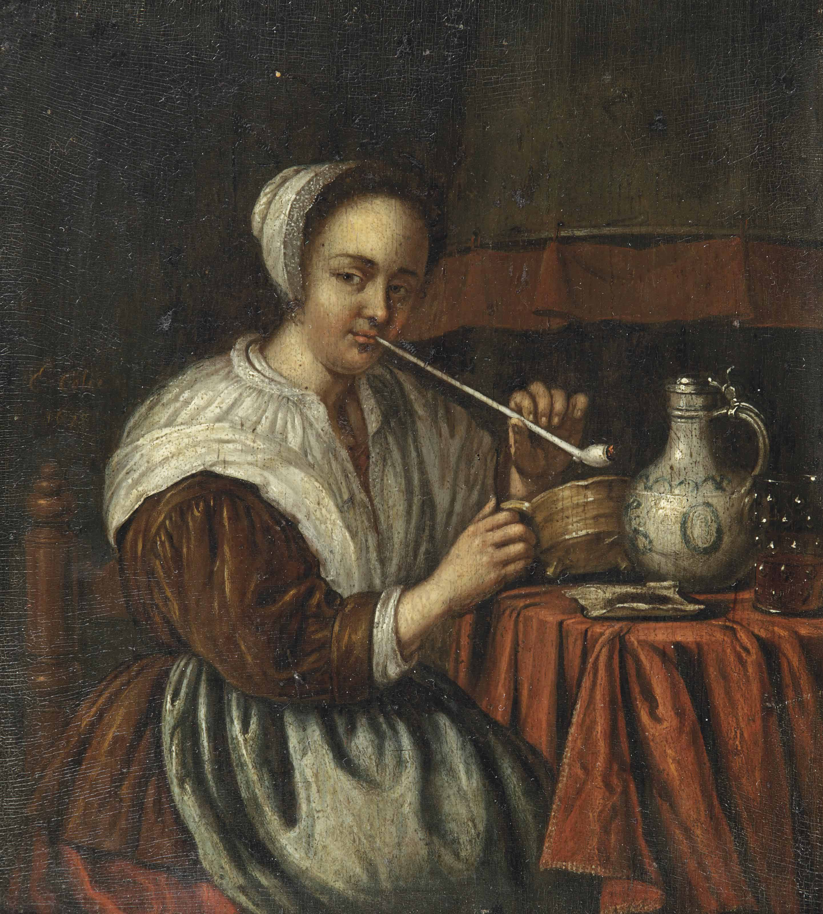 A woman smoking a pipe at a table