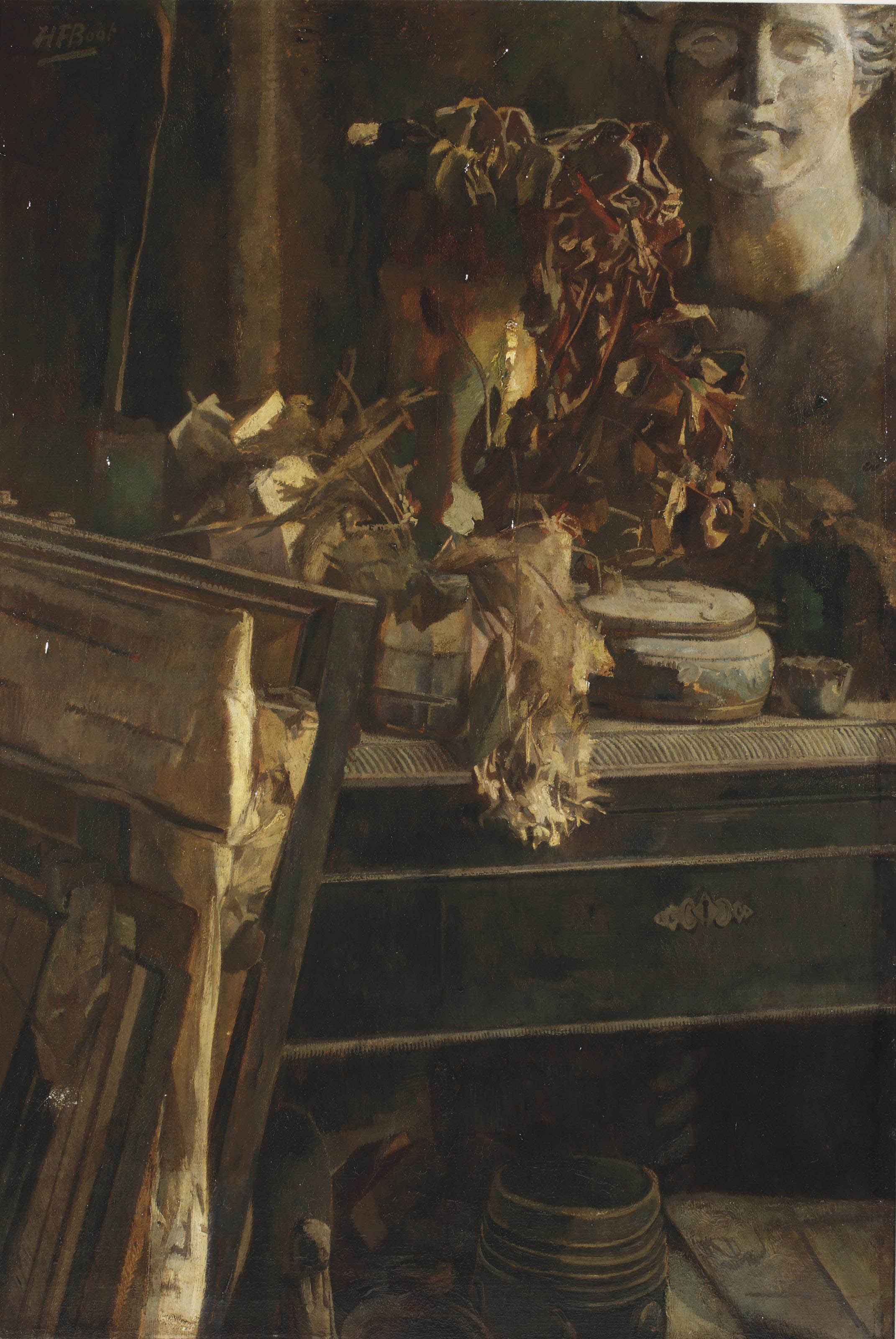 A still life with a plaster head in the artist's studio