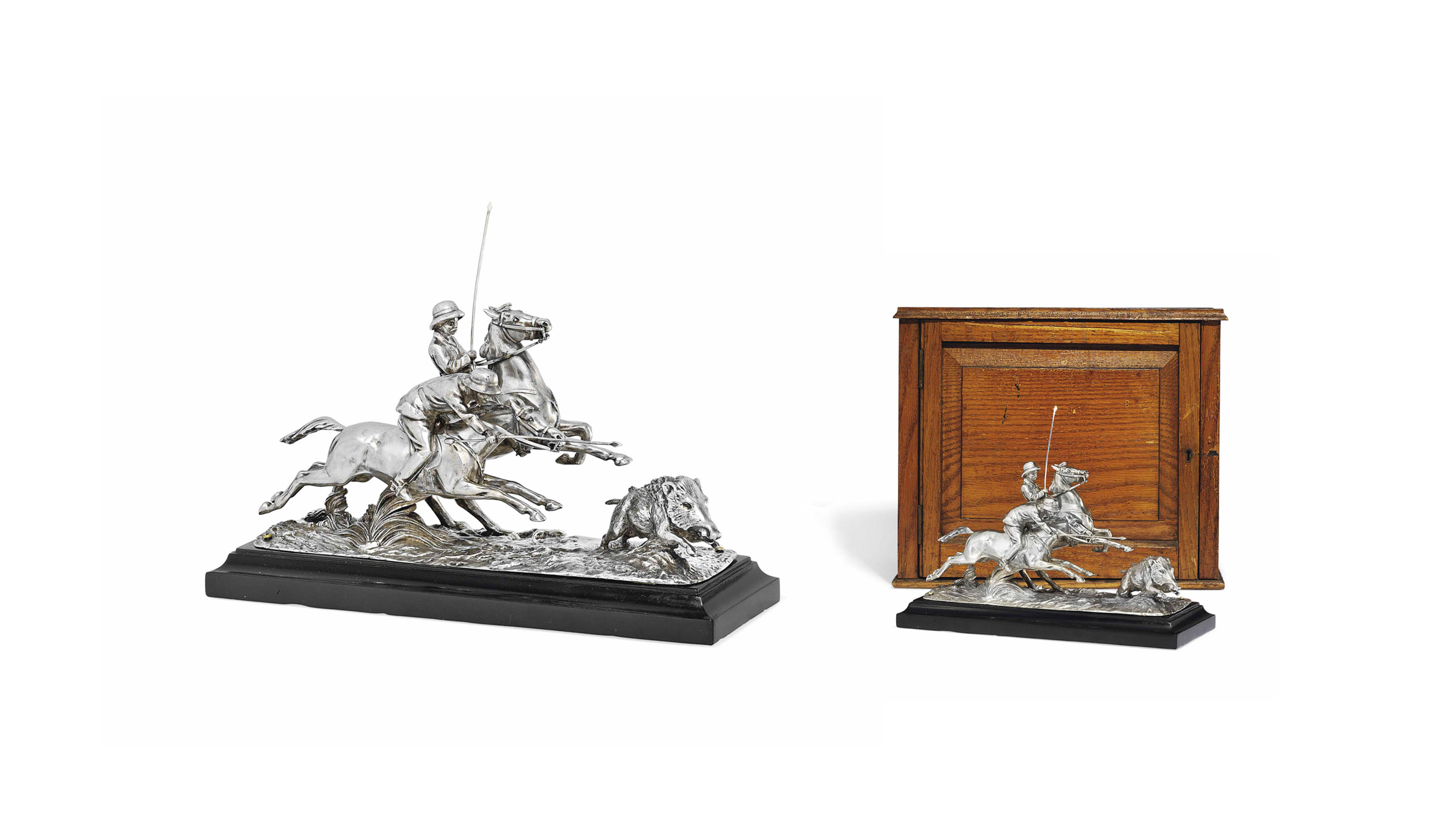 A GEORGE V SILVER CENTREPIECE IN THE FORM OF A BOAR HUNT