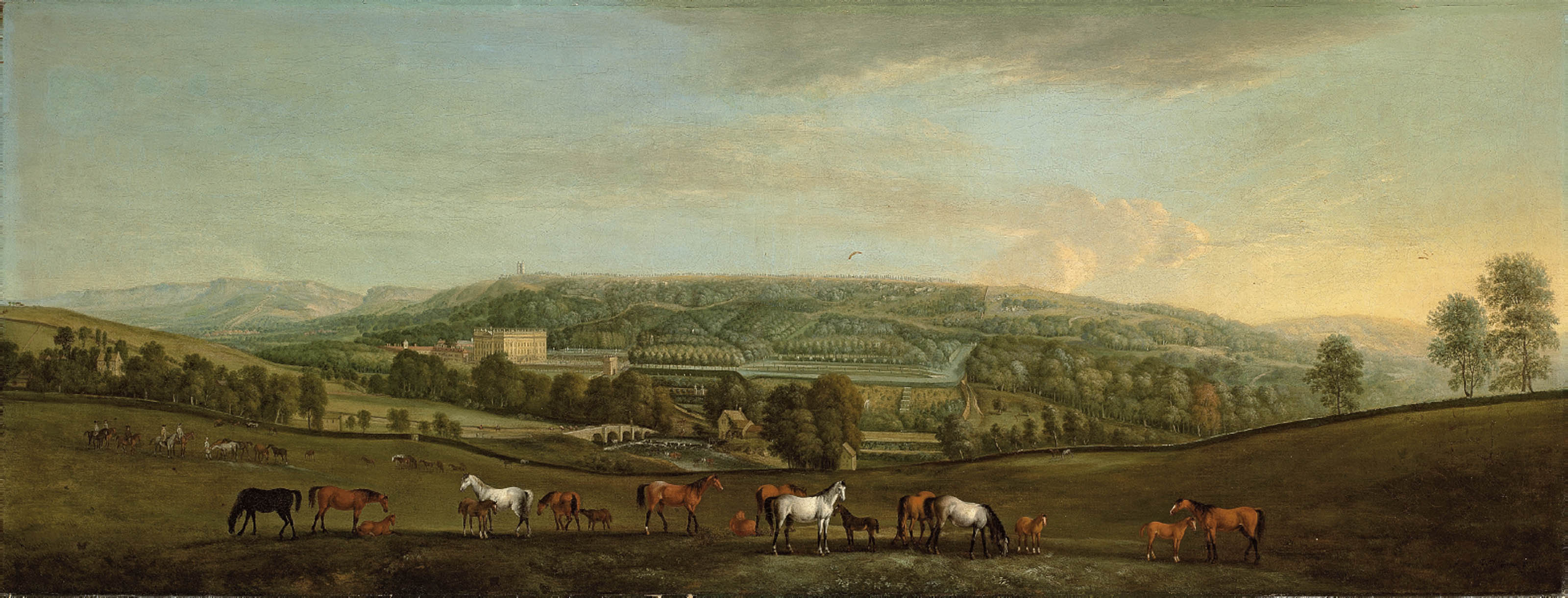 A panoramic view of Chatsworth House and Park, with mares and foals in the foreground