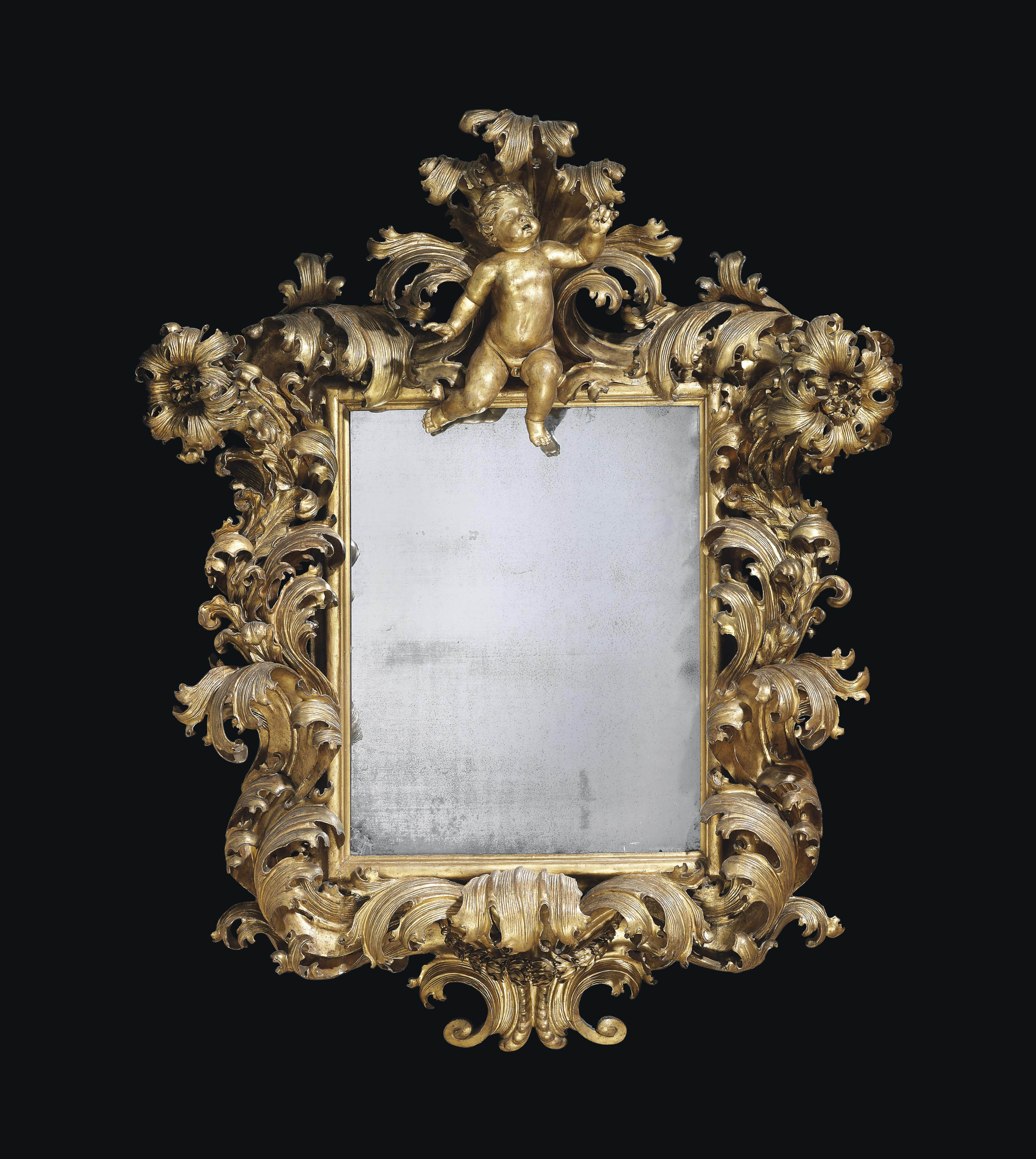 A NORTH ITALIAN GILTWOOD MIRROR