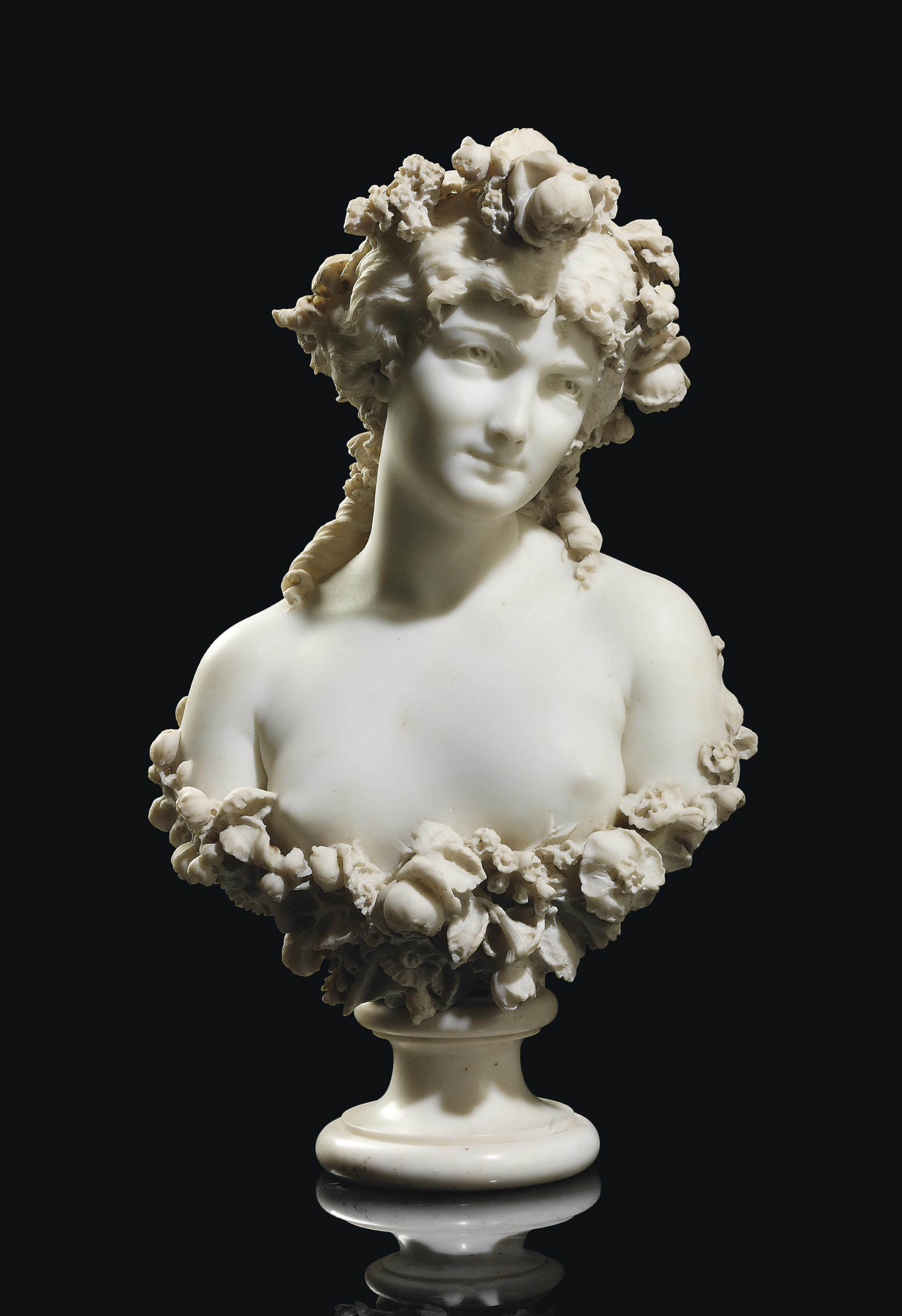 AN ITALIAN WHITE MARBLE BUST OF FLORA