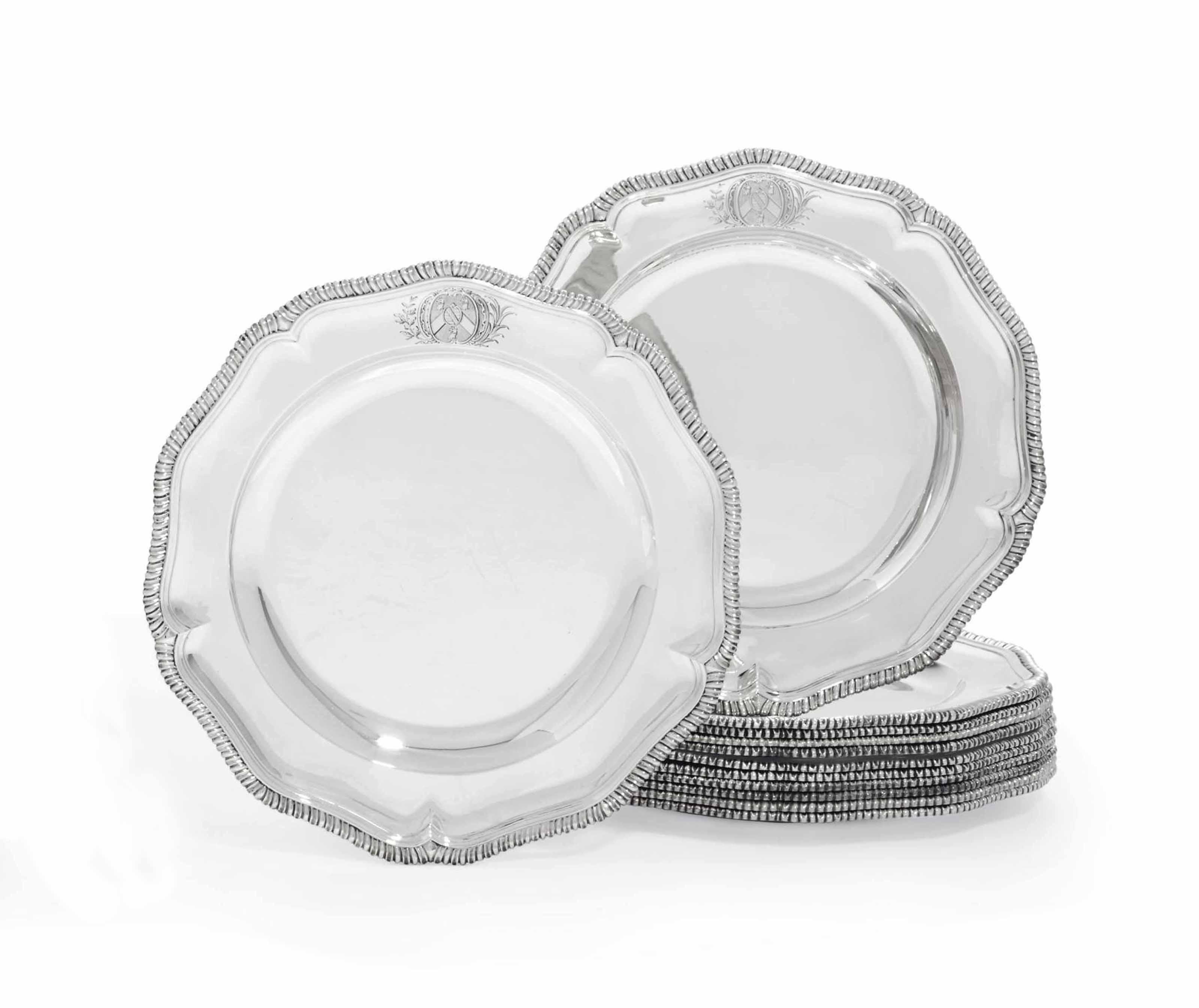 A SET OF TWELVE GEORGE II SILVER DINNER-PLATES