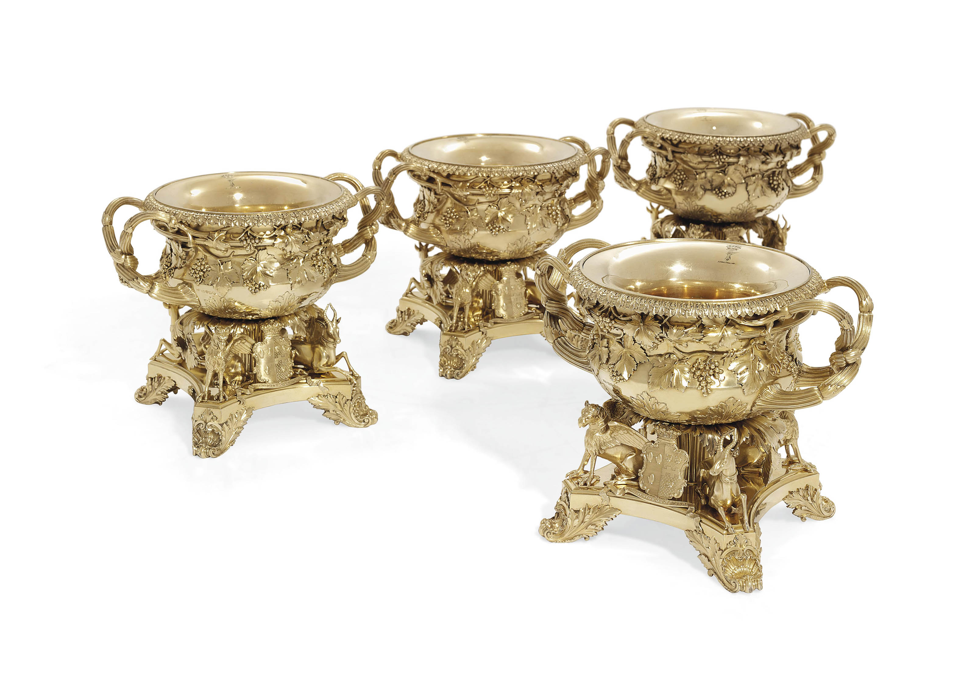 A SET OF FOUR GEORGE III SILVER-GILT WINE-COOLERS, COLLARS AND LINERS