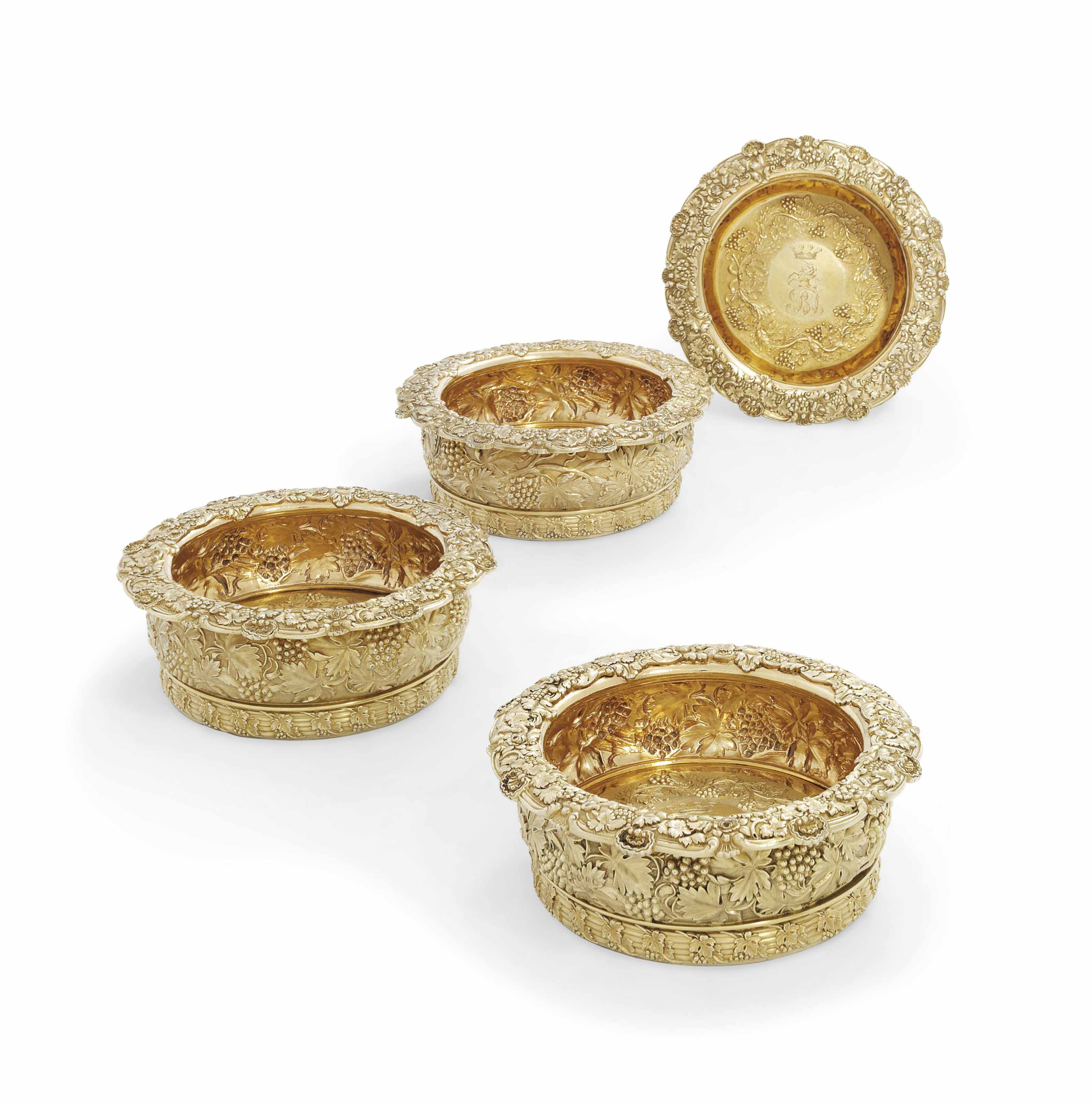 A SET OF FOUR GEORGE IV SILVER-GILT WINE-COASTERS FROM THE SAMPAIO SERVICE