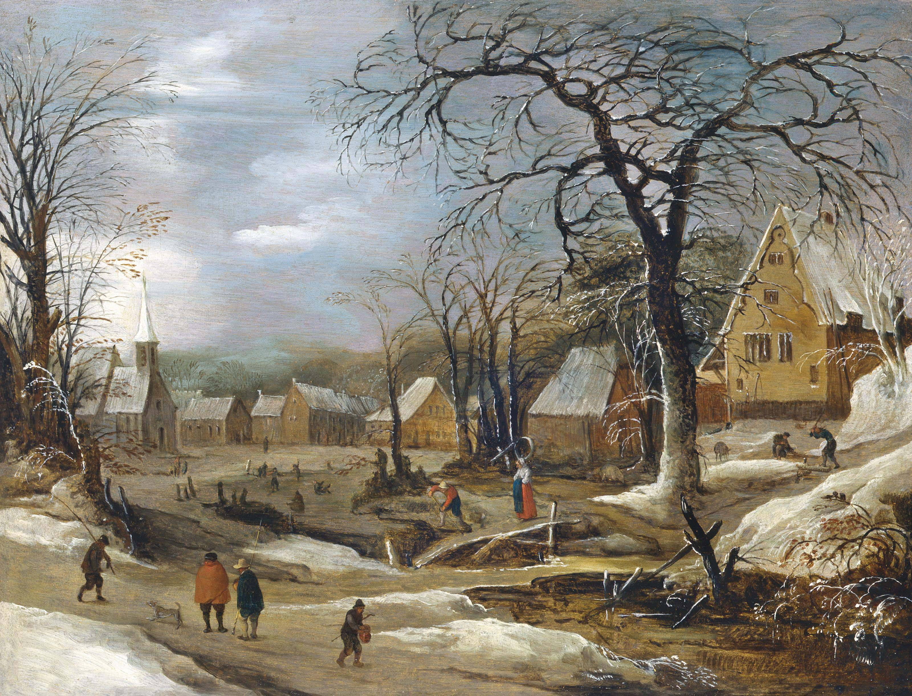 A winter landscape with figures by a frozen river in a village