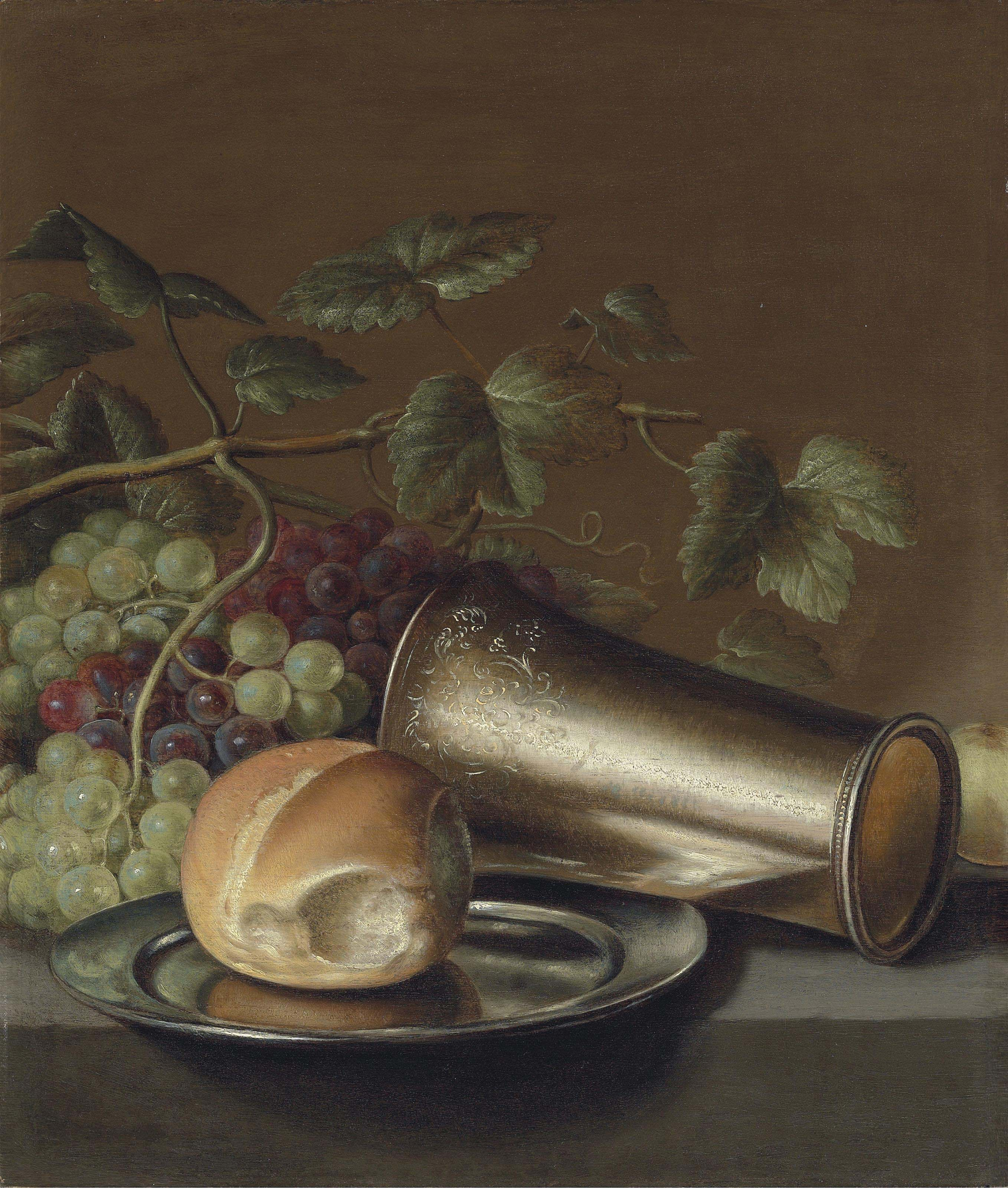 Bread on a pewter platter, an engraved silver cup, with grapes and a plum on a stone ledge