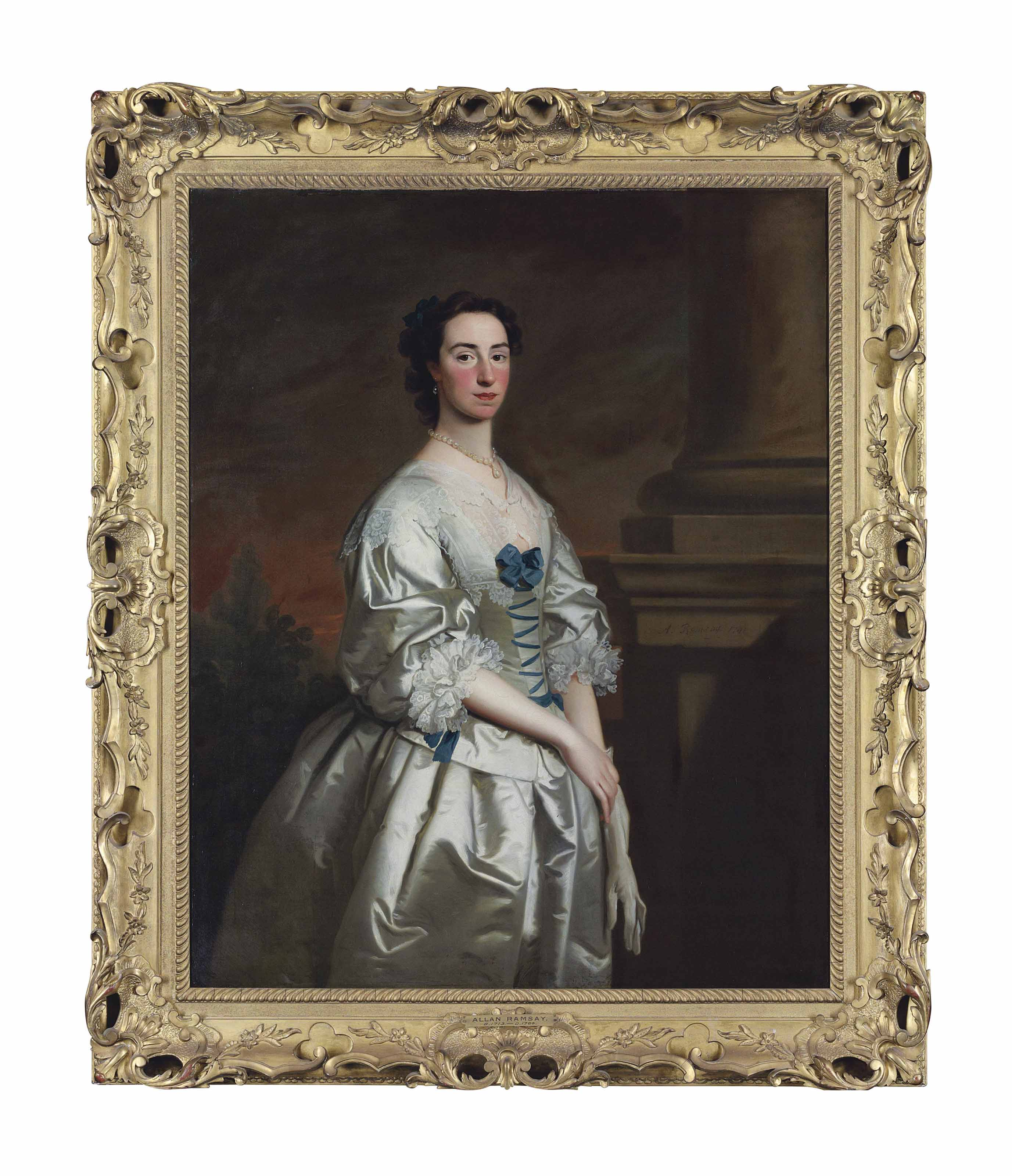 Portrait of a lady, three-quarter-length, in a white satin Van Dyck dress, trimmed with blue bows and lace, beside a column, in a landscape