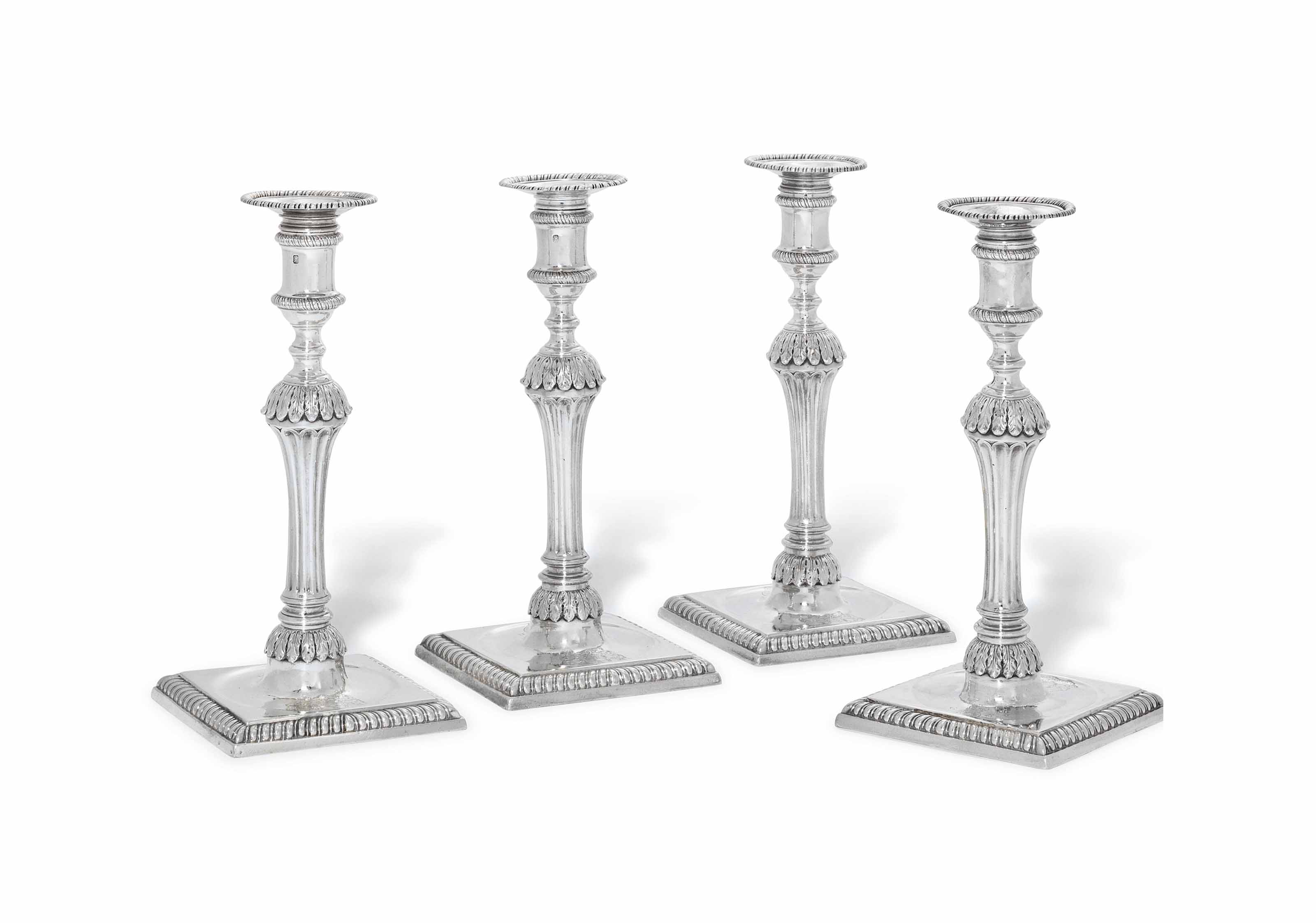 A SET OF FOUR GEORGE III ROYAL SILVER CANDLESTICKS
