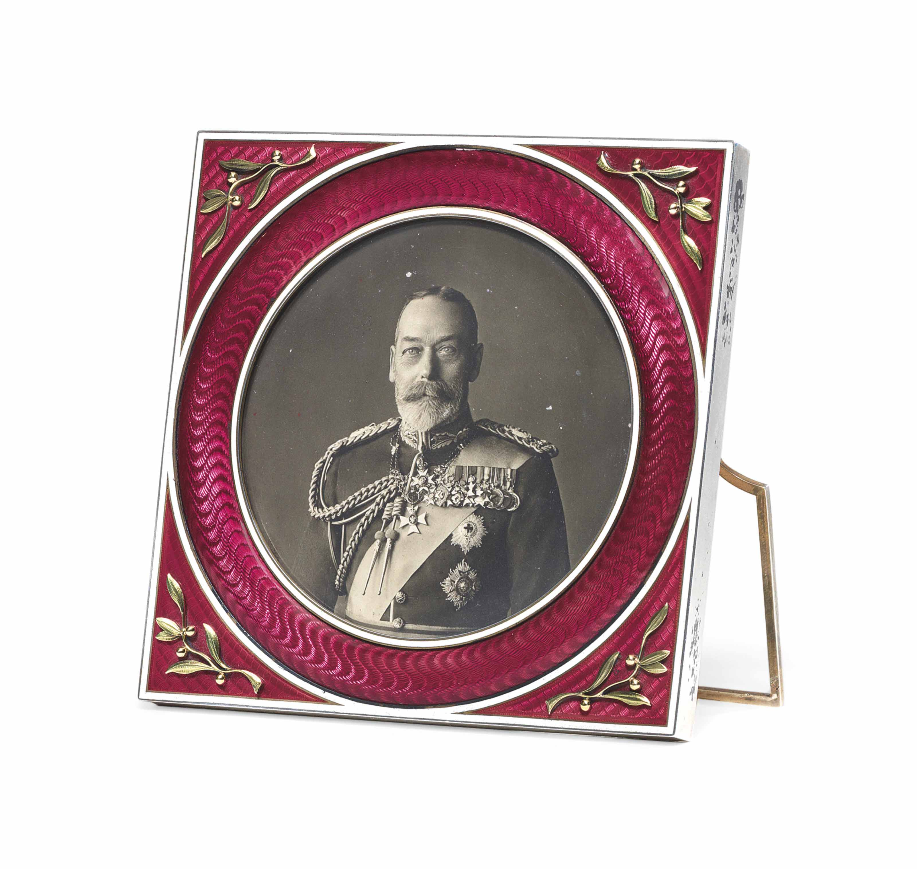 A PARCEL-GILT SILVER-MOUNTED AND GUILLOCHÉ ENAMEL PHOTOGRAPH FRAME