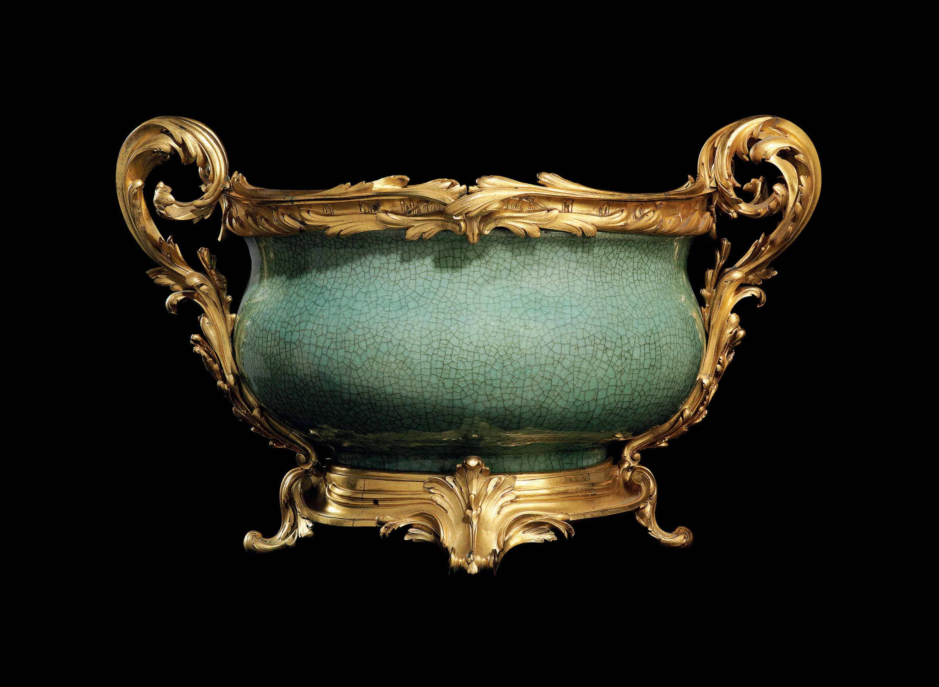 A LOUIS XV ORMOLU-MOUNTED CHINESE CRACKLE-GLAZED CELADON PORCELAIN BOWL OF EXCEPTIONAL SIZE