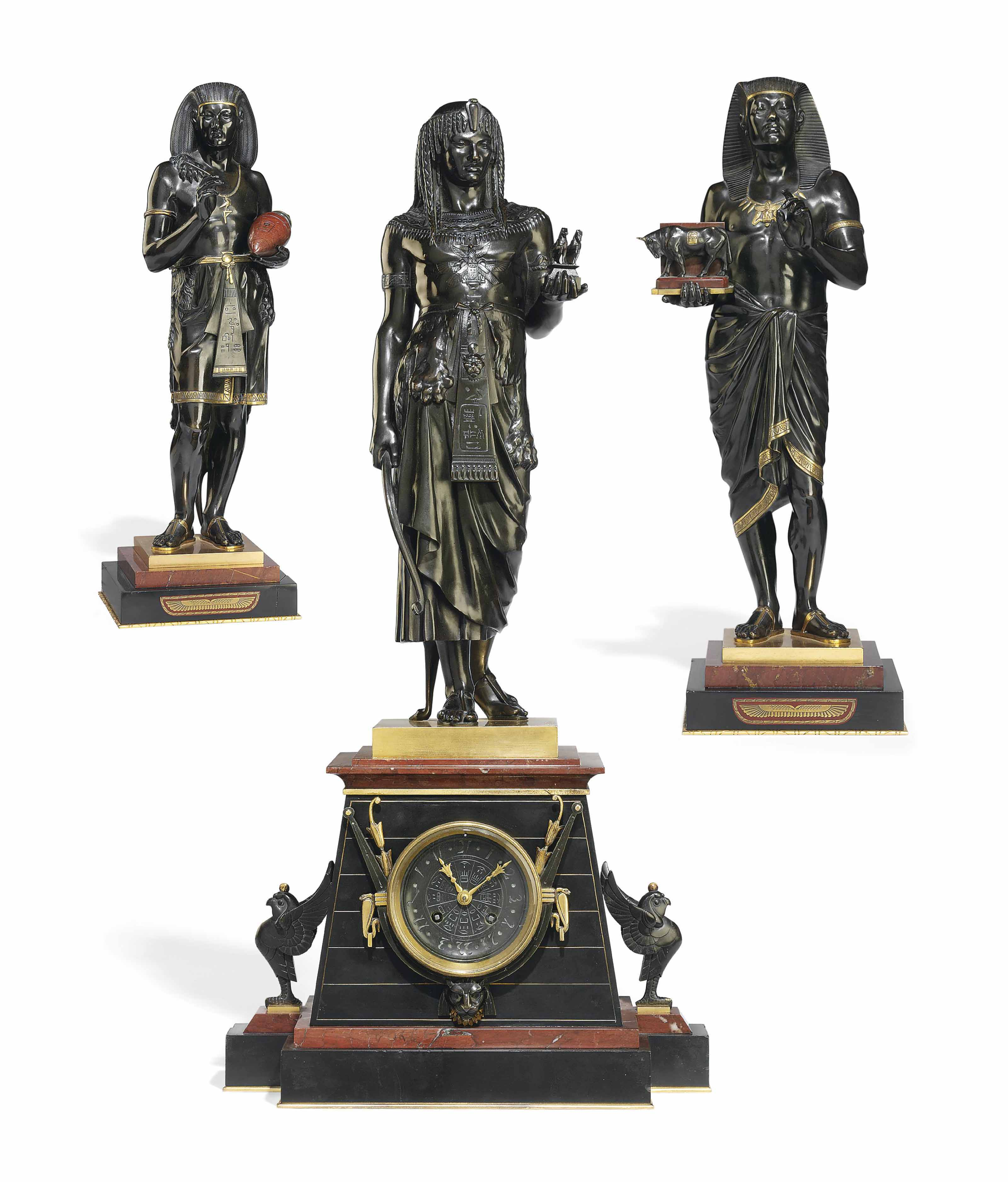 A FRENCH PARCEL-GILT BRONZE, ROUGE AND BLACK MARBLE THREE-PIECE FIGURAL CLOCK GARNITURE