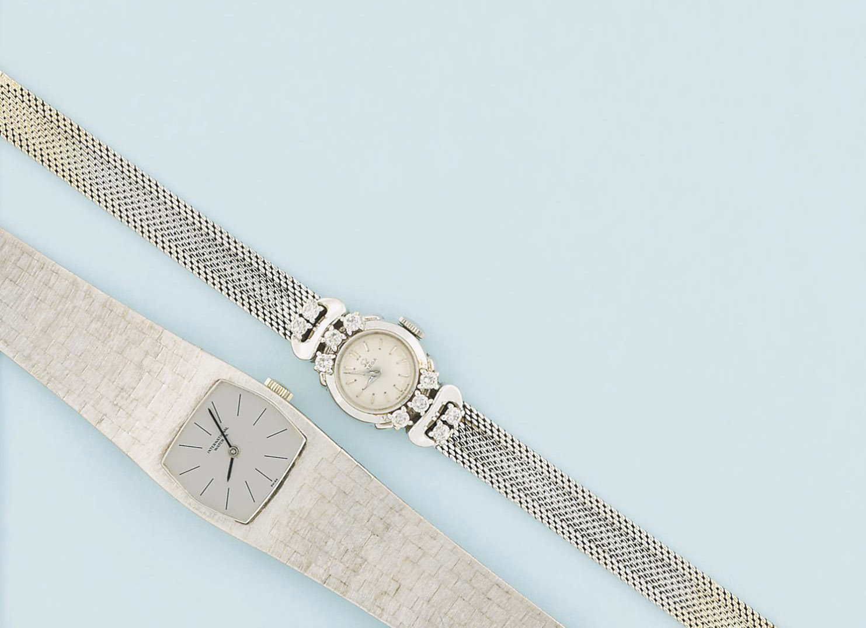 Three wristwatches
