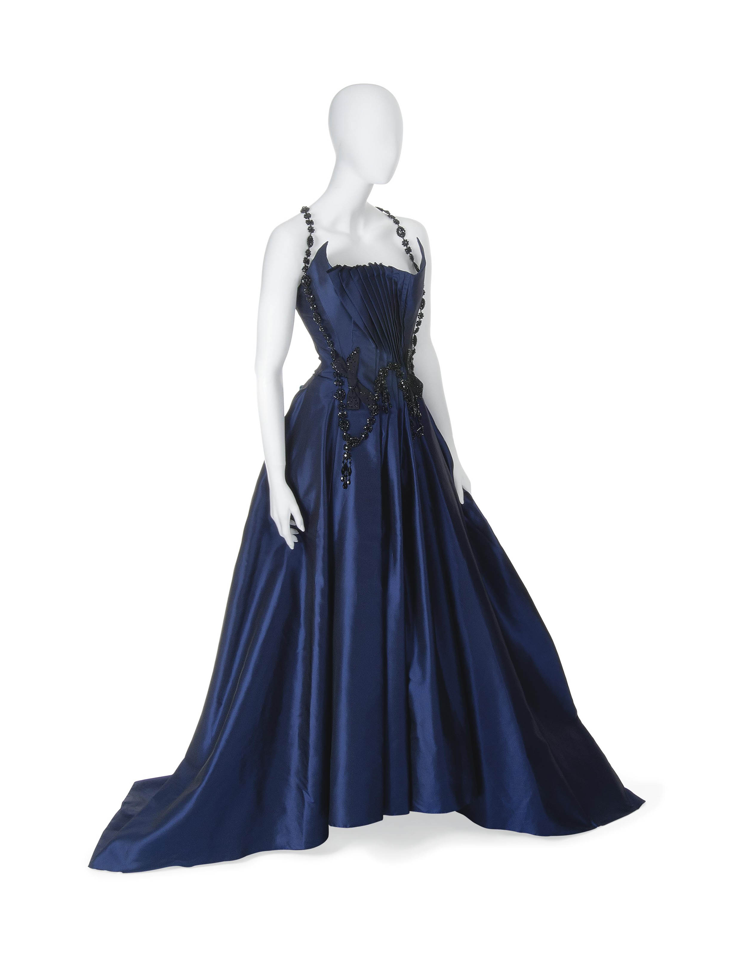 A MAGNIFICENT BALL GOWN OF MIDNIGHT BLUE SATIN