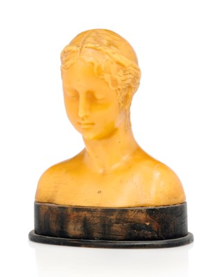 A SCULPTED WAX BUST IN THE FLO