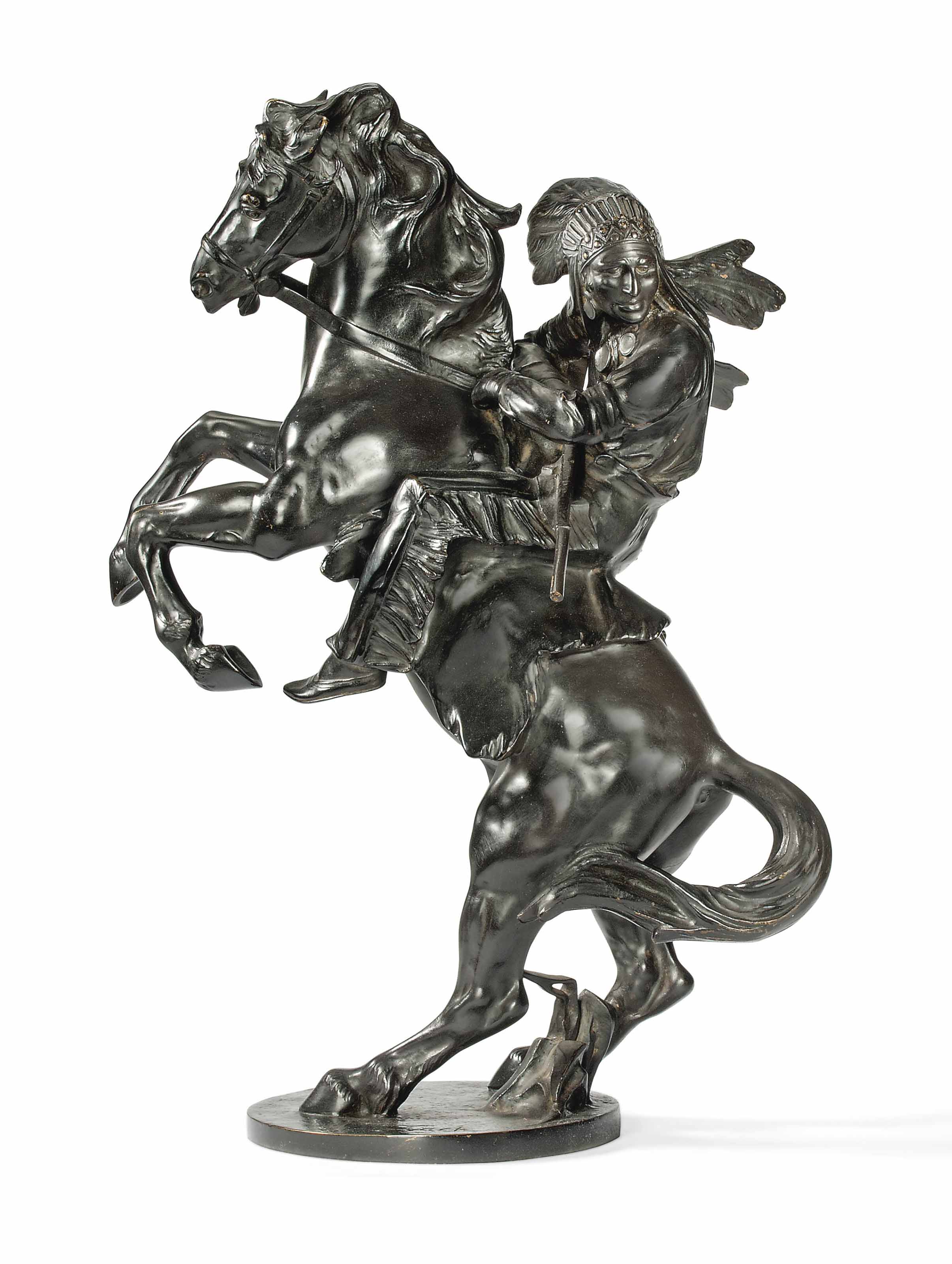 'INDIAN RIDER' A LARGE PATINATED BRONZE GROUP BY BRUNO ZACH